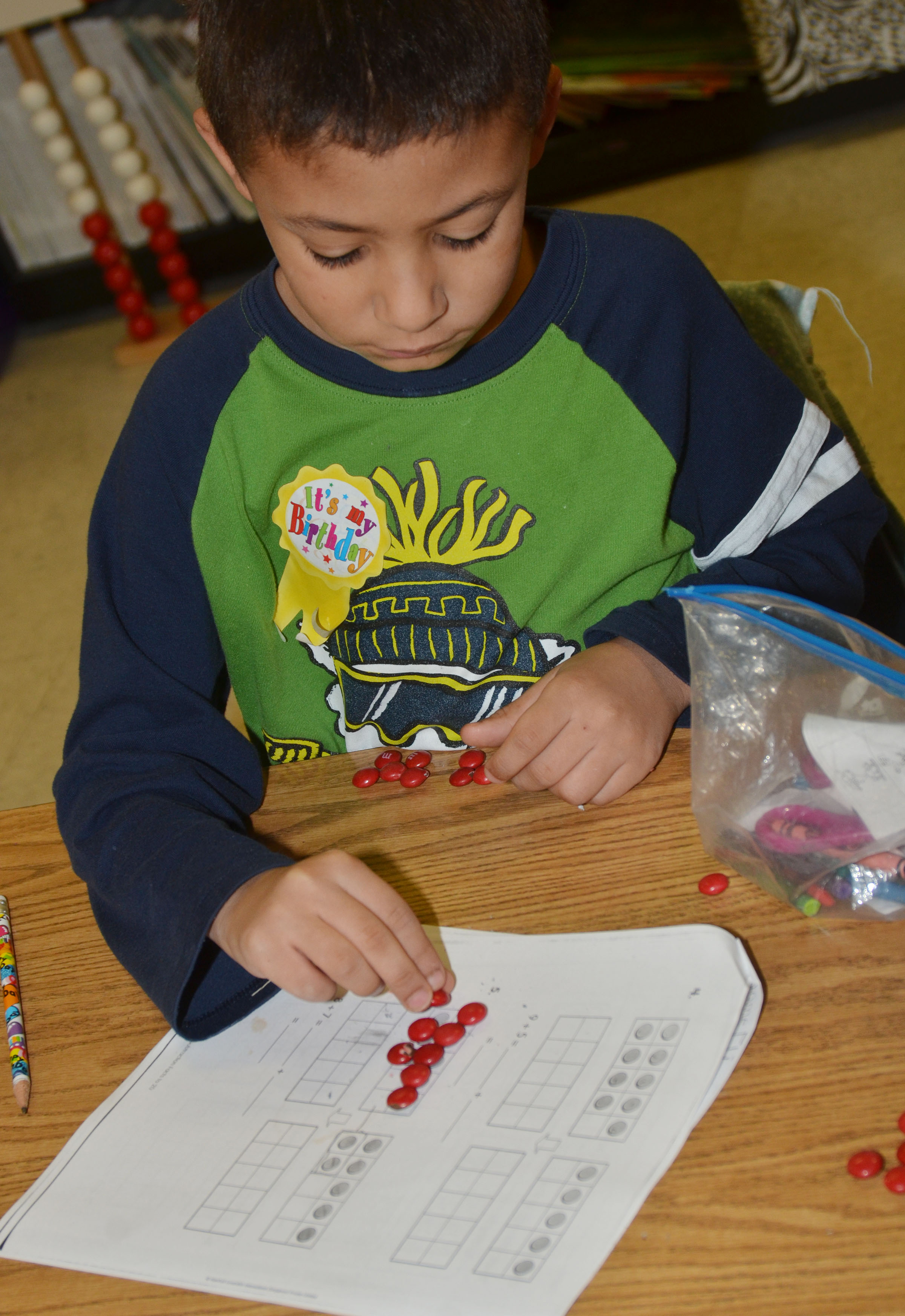 CES first-grader Elijah Williams counts with M&Ms.