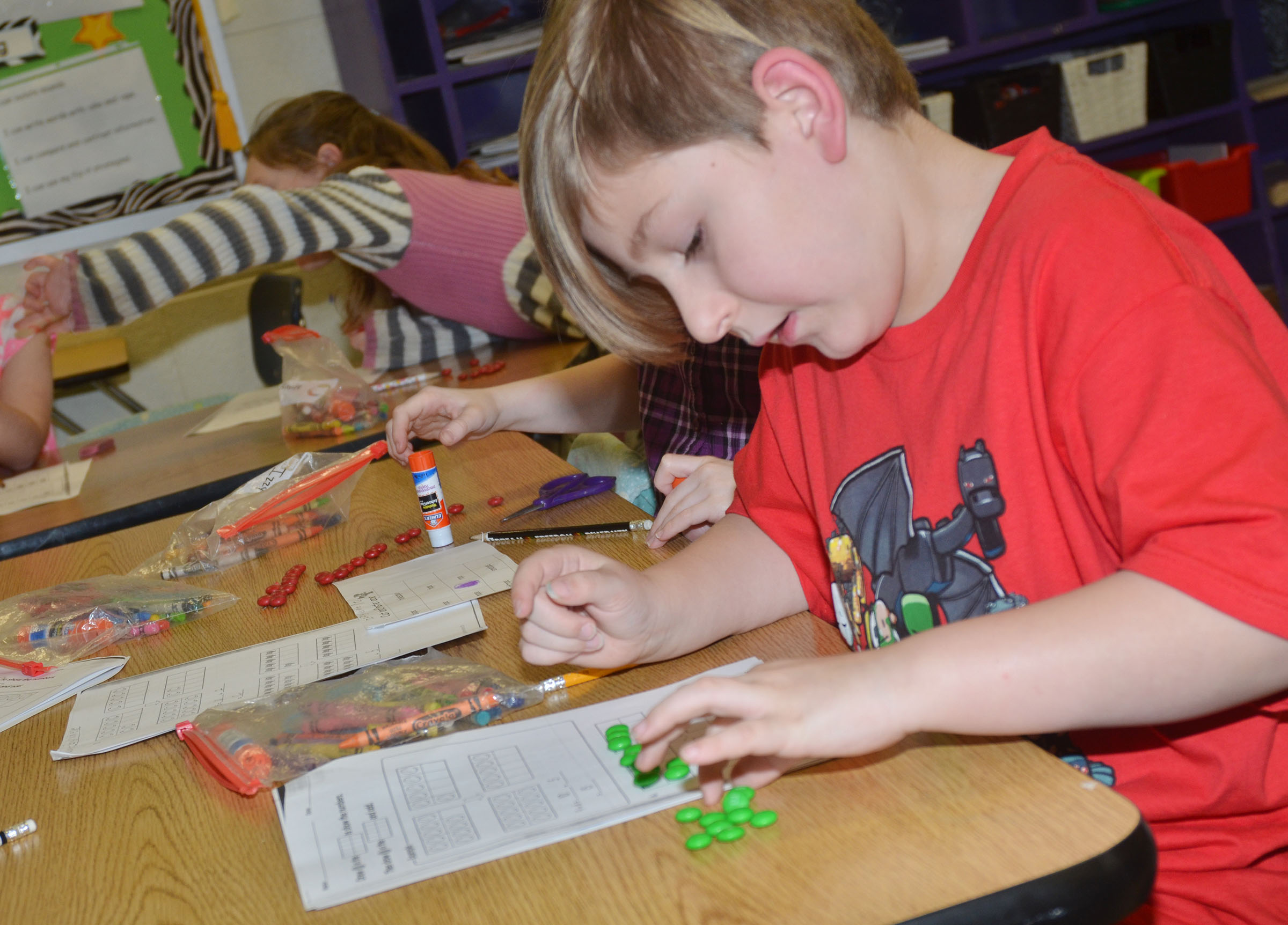 CES first-grader Tommy Caswell counts with his M&Ms.