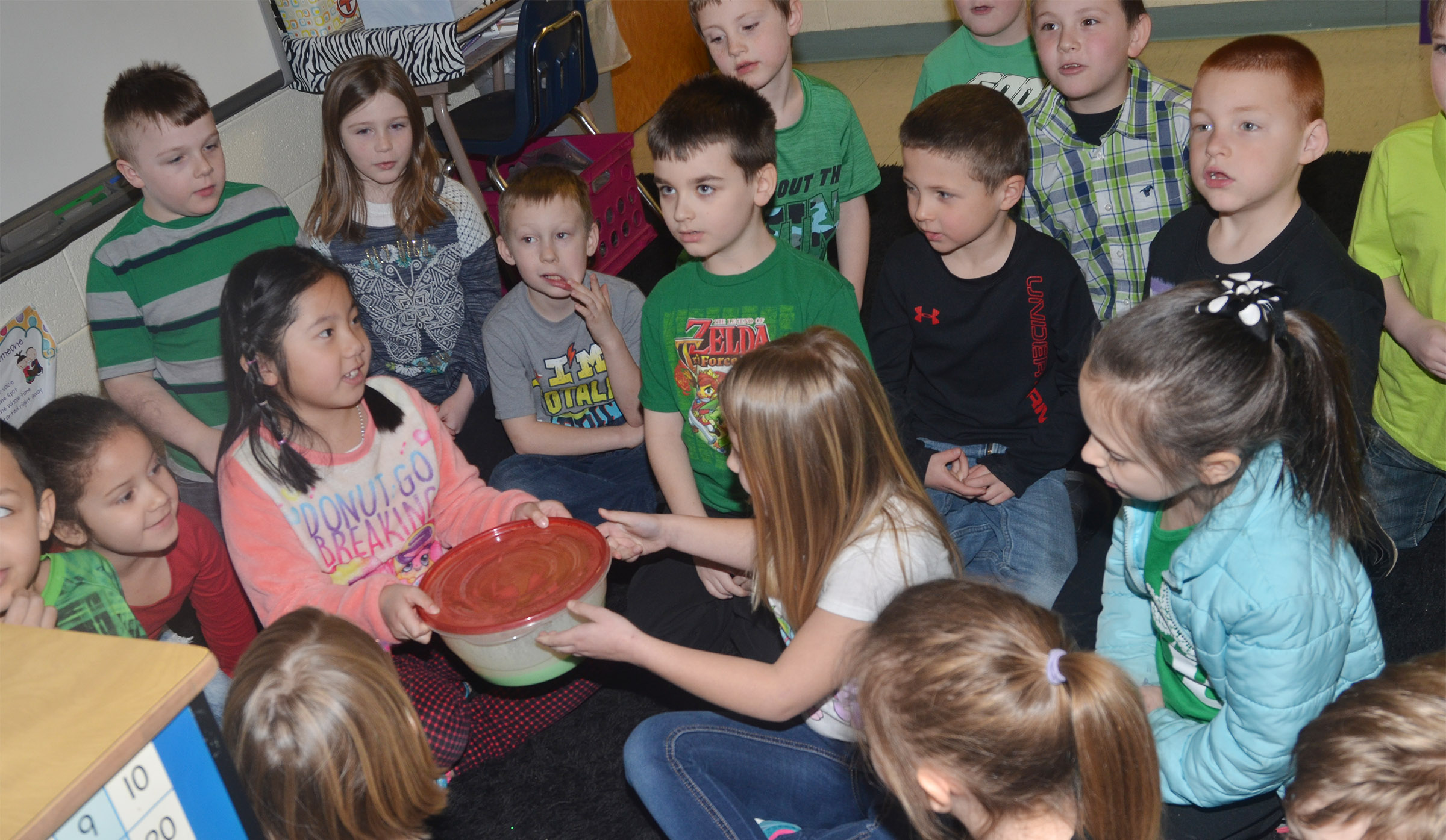 CES first-graders mix their pudding and were surprised when it turned green.