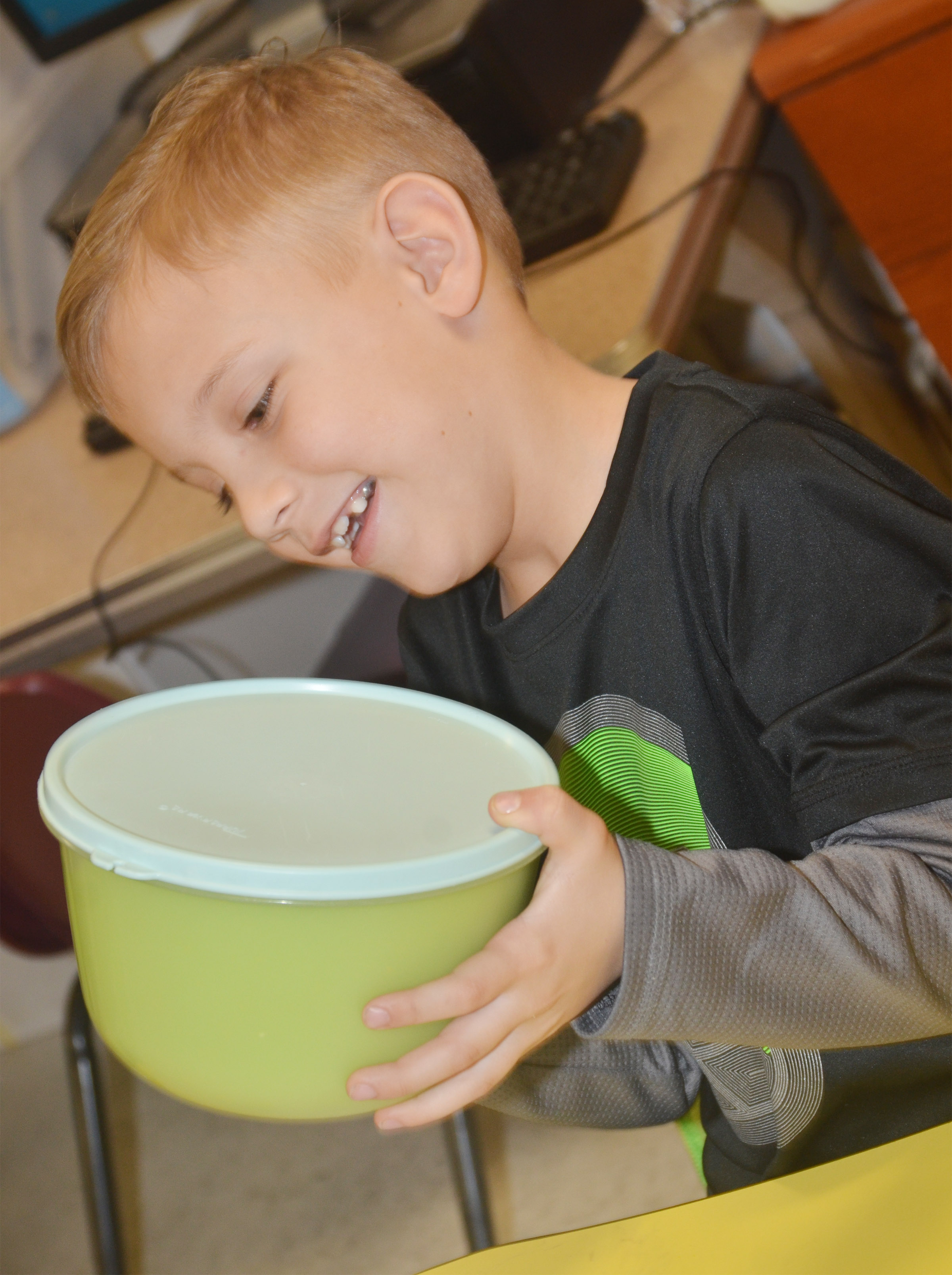 CES first-grader Gabe Prior watches as the pudding mixture turns green.