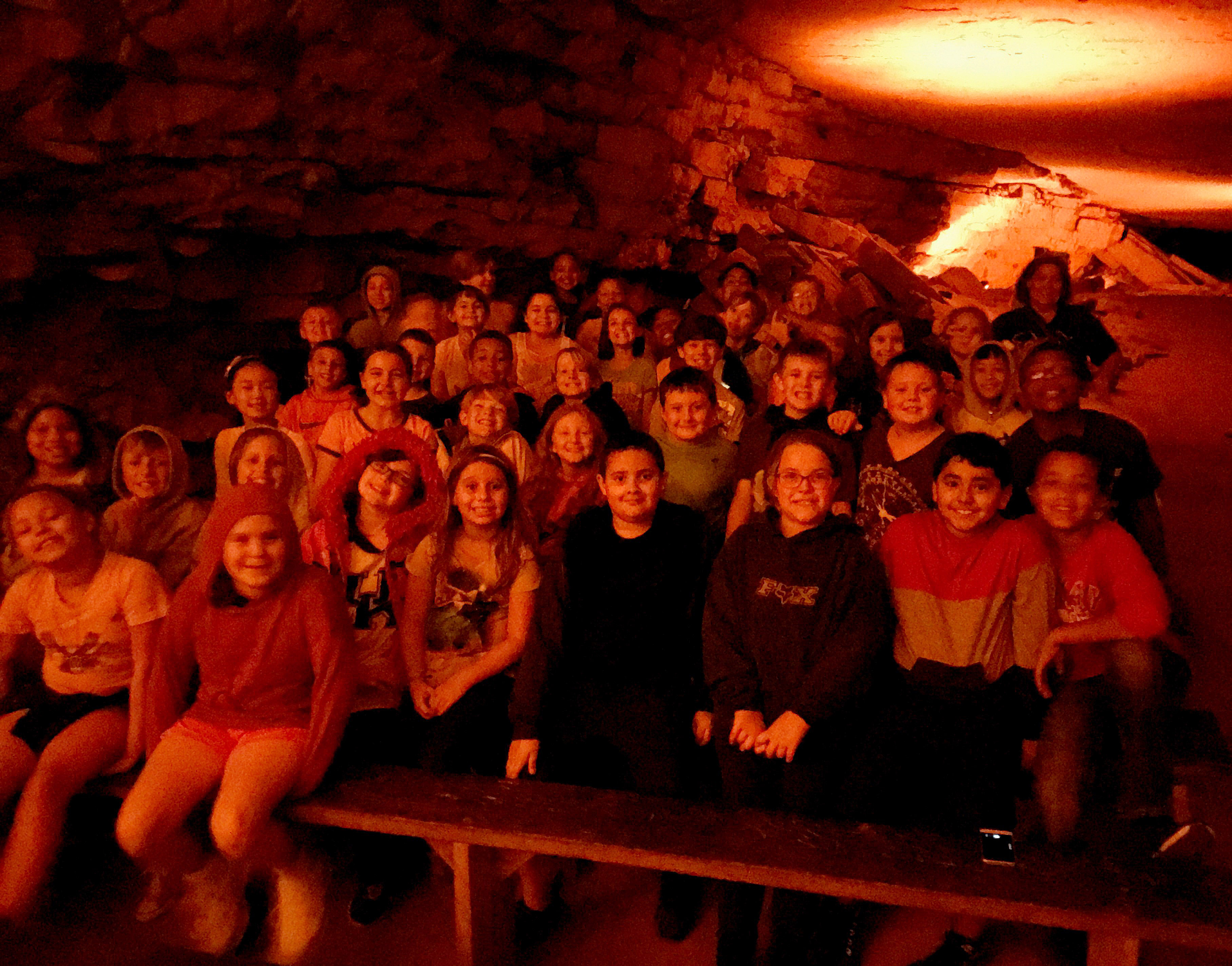 CES fourth-graders sit inside Mammoth Cave.