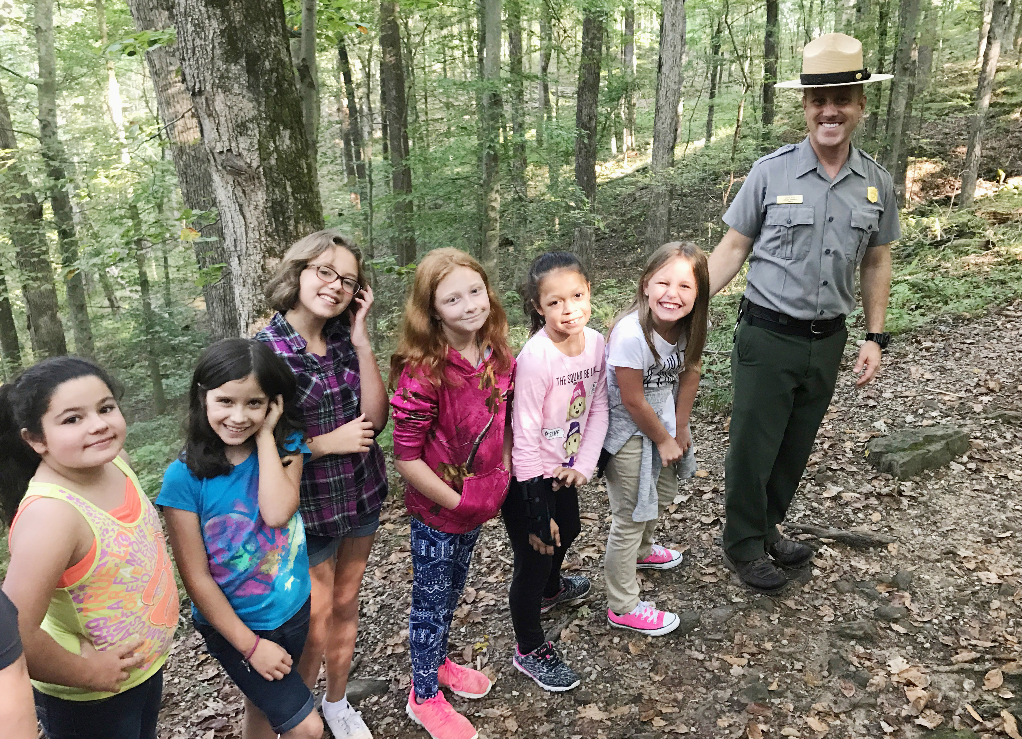 CES fourth-graders pose for a photo with a park ranger. From left are Brooklyn Boudreaux, Zehavah Negron, Trinity McFarland, Savannah Wethington, Breona Bridgewater and Madisyn Bradfield.