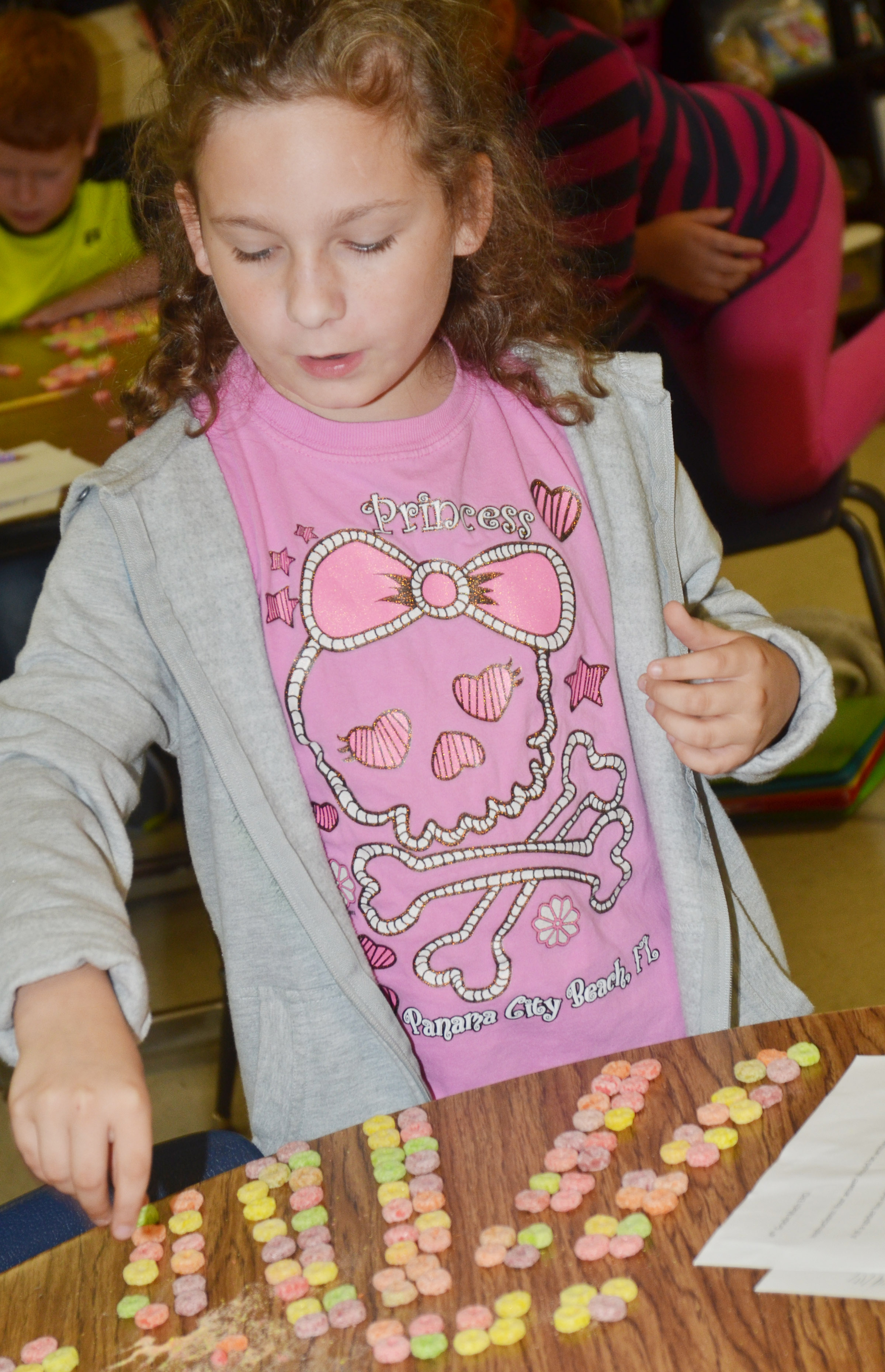 CES fourth-grader Aliyah Burton counts using pieces of cereal.