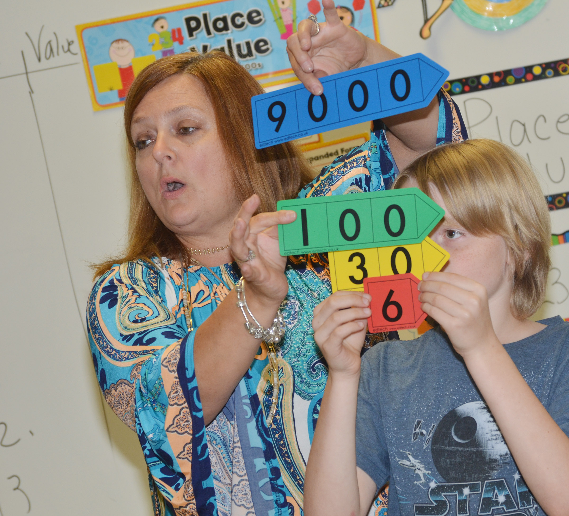 CES teacher Garnetta Murrell gets some help from fourth-grader Devin Underwood as she reviews place value.