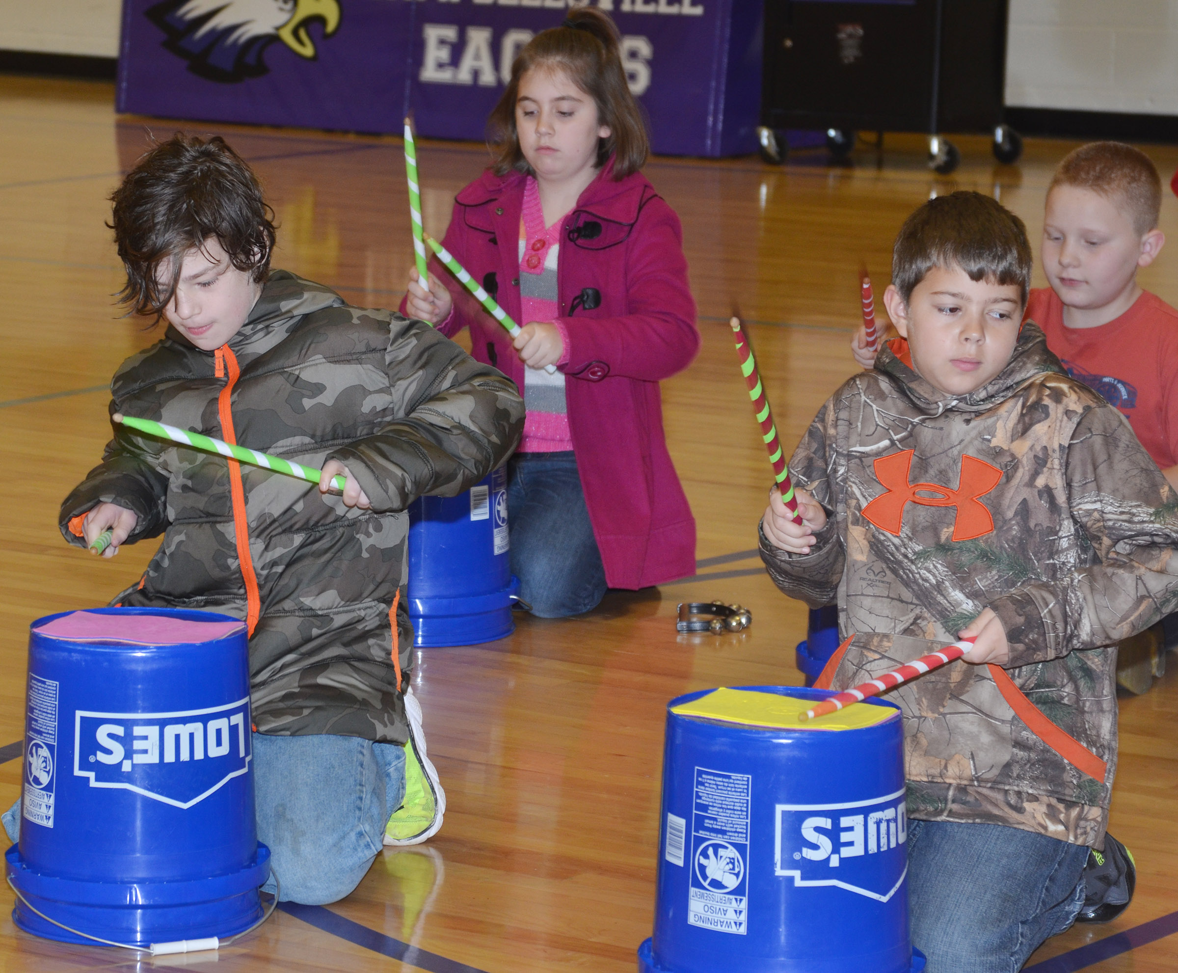 "CES fourth-graders perform ""Run, Run, Rudolph."" In front are Joshua Weise, at left, and Stanley Napper. Back, Adrianna Garvin and Isaiah Jeffries."