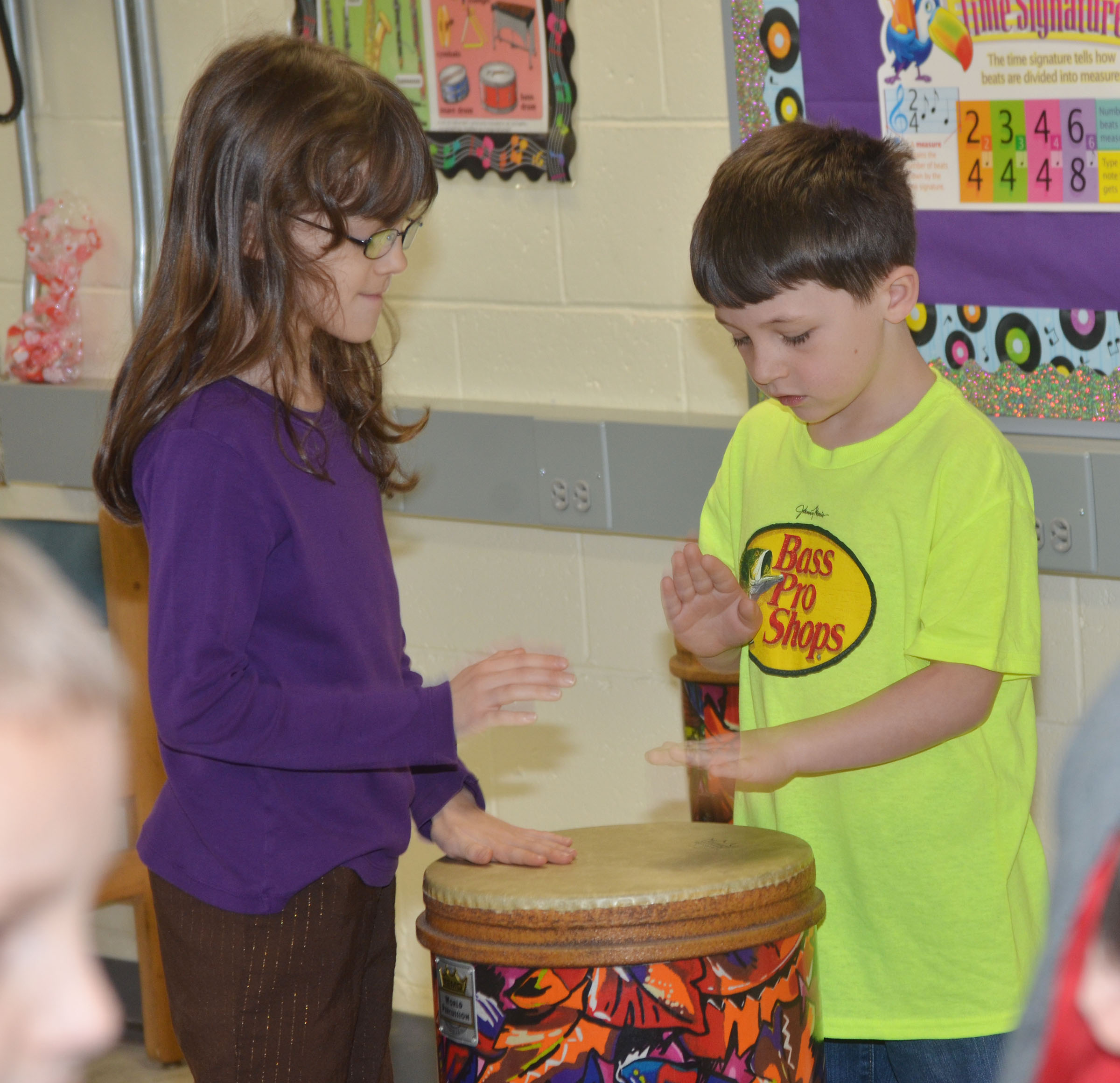 CES second-graders Lilly Wise, at left, and Codey Parks practice rhythms on the drums.