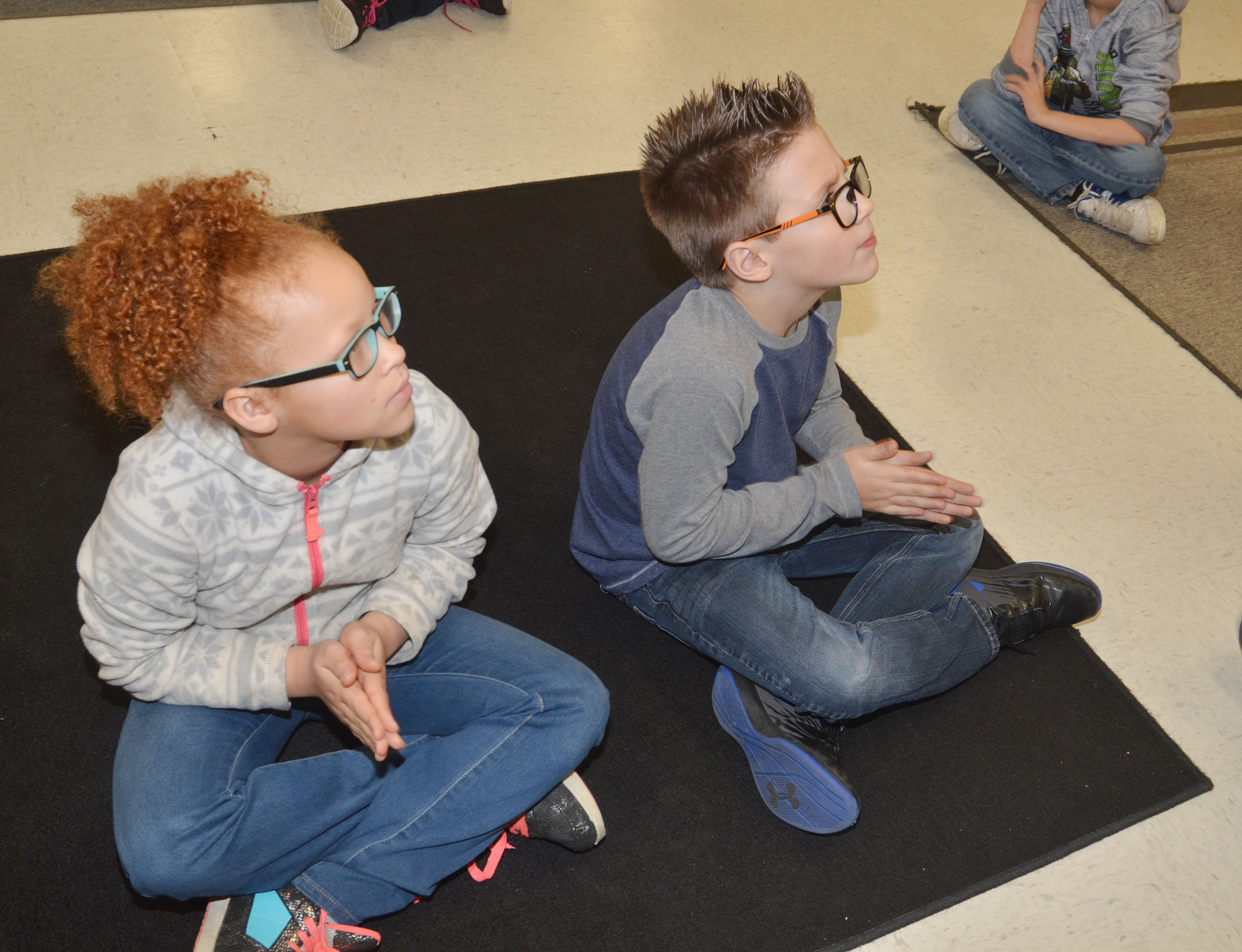 CES second-graders Kallie Taylor, at left, and Dalton Shively clap rhythms.