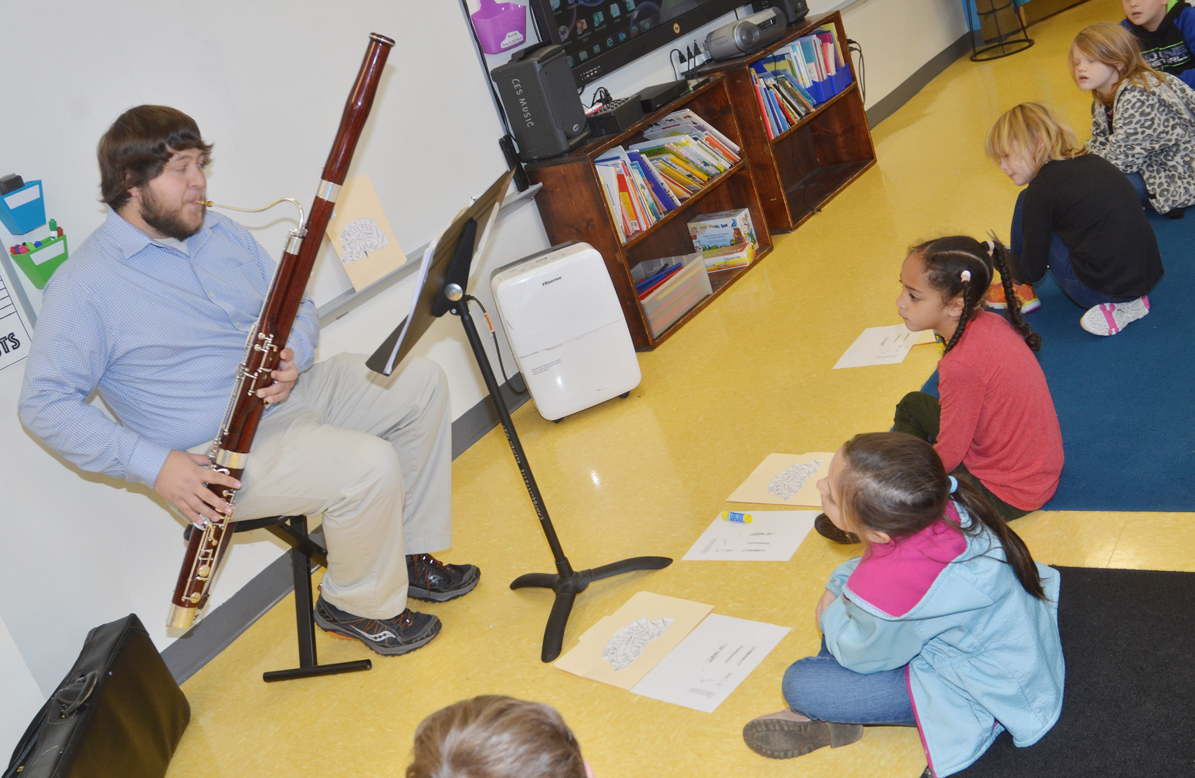 Campbellsville University education student Scott Caffee plays the bassoon for CES second-graders.