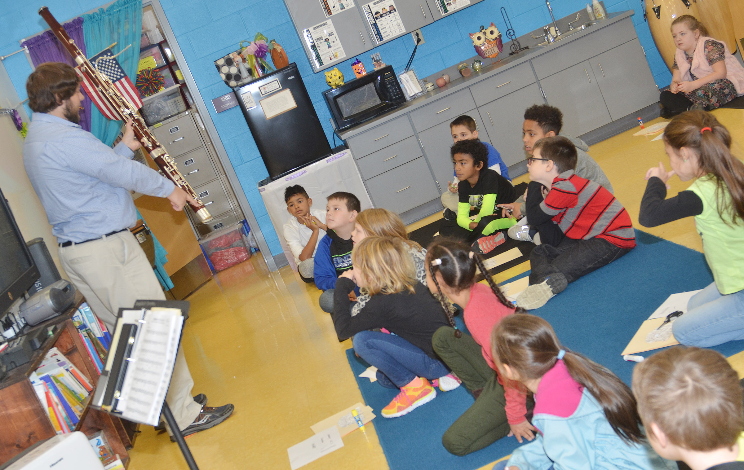 Campbellsville University education student Scott Caffee shows CES second-graders the parts of a bassoon.