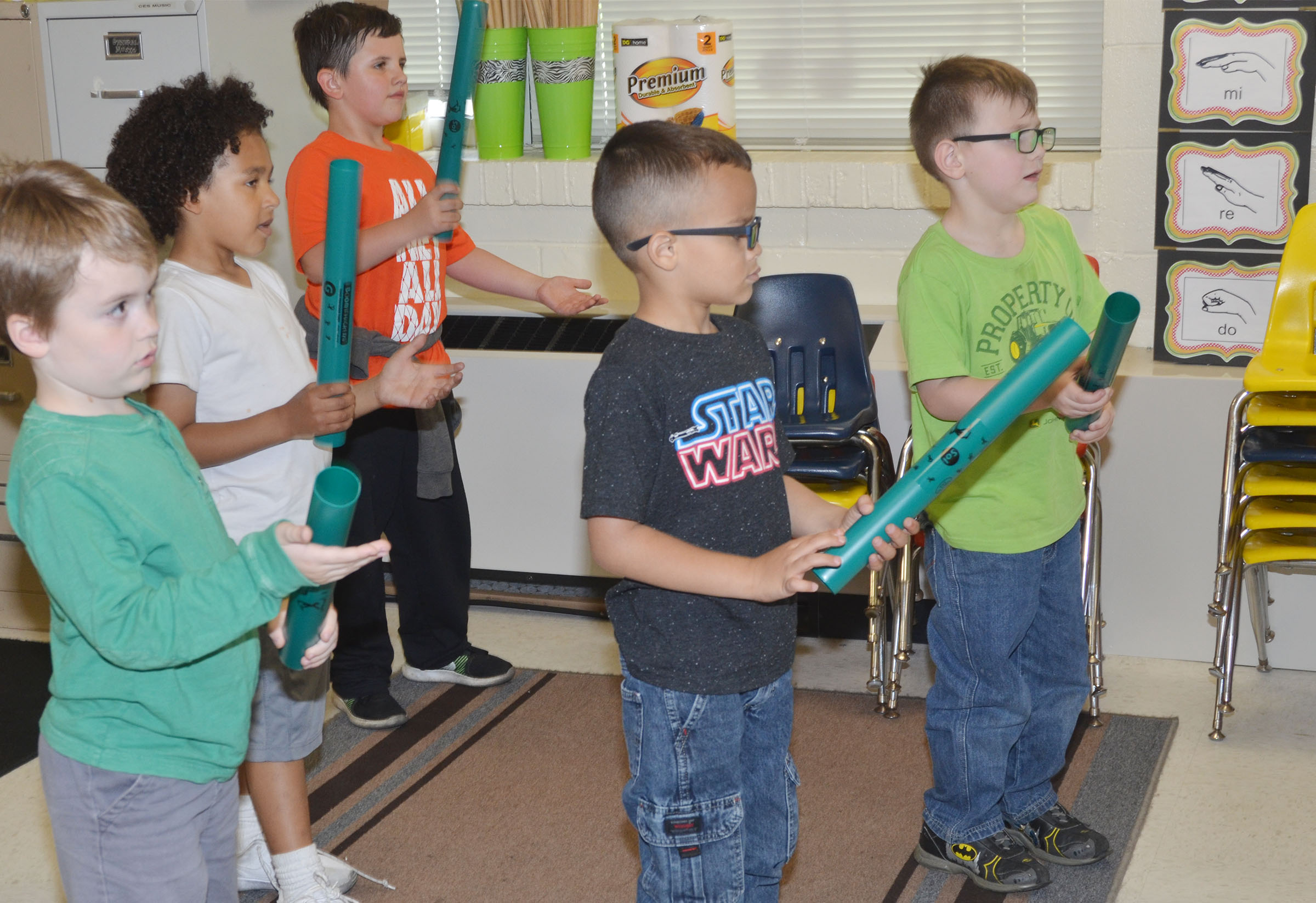 CES kindergarteners, from left, Gavin Williams, Travontae Jones, Casen Meredith, Davian Taylor and John Lane play the boom whackers.