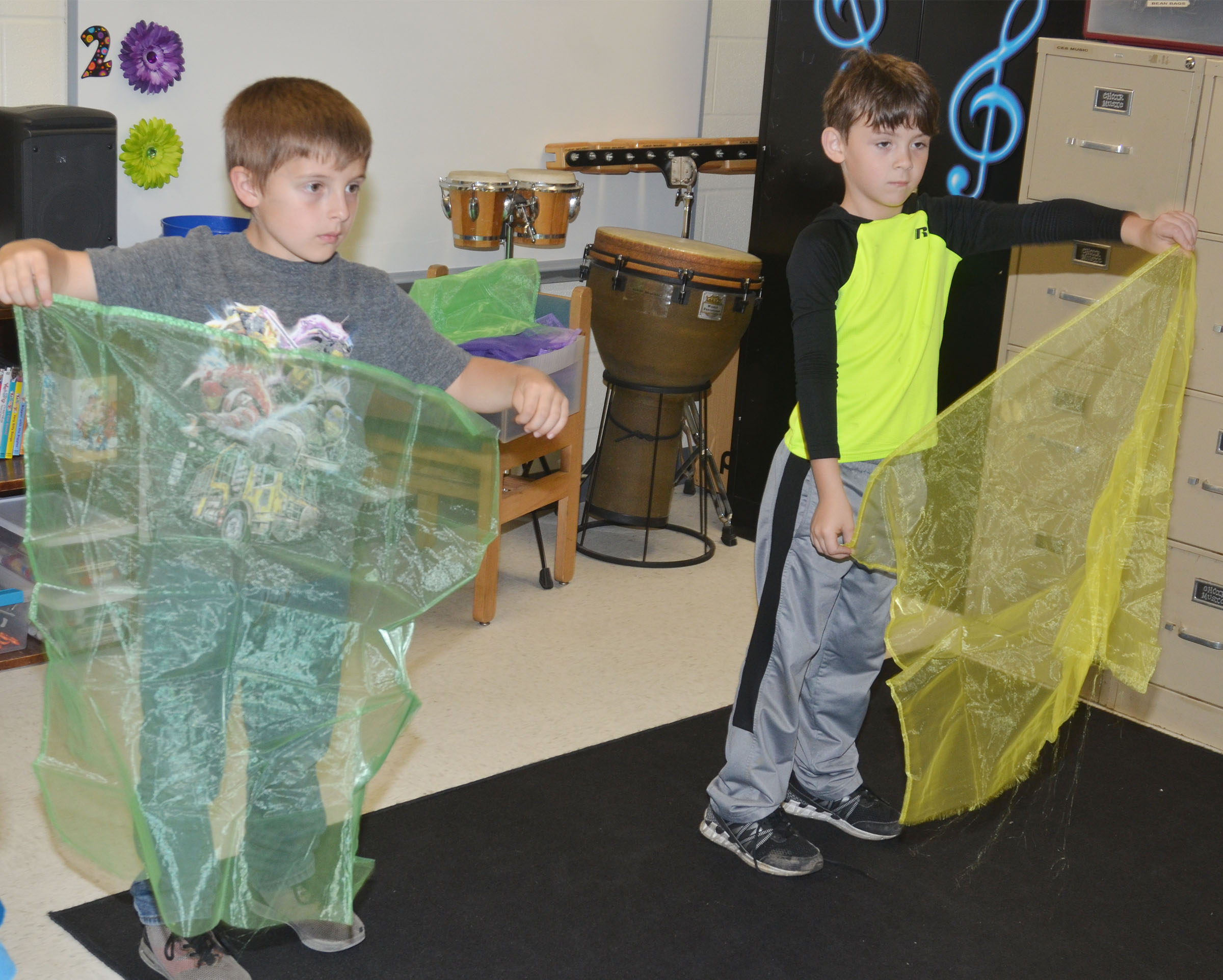 CES kindergarteners Ayden Andrew, at left, and Bentley Shively keep a beat with scarves.