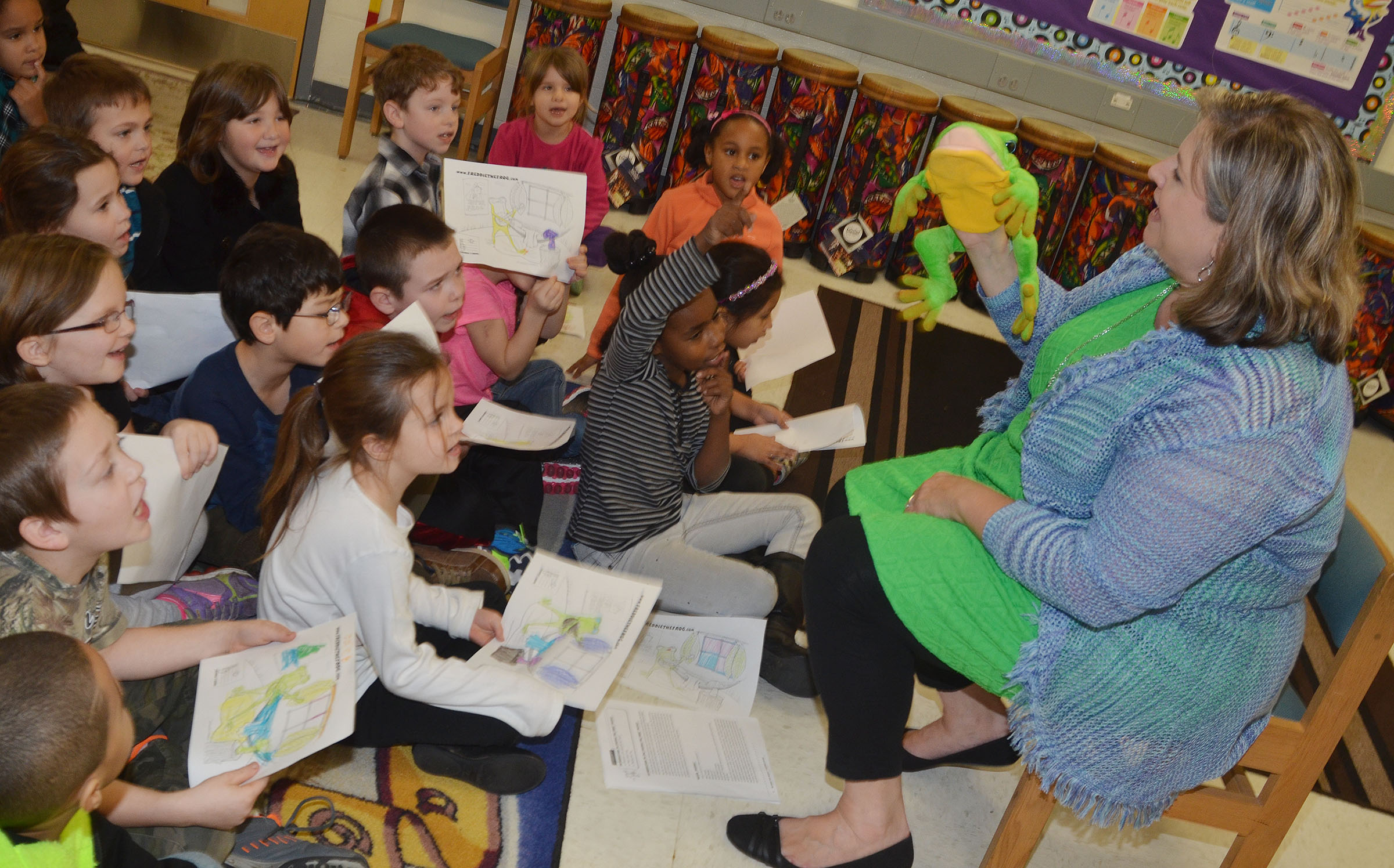 CES teacher Cyndi Chadwick teaches students about music with help from Freddie the Frog.