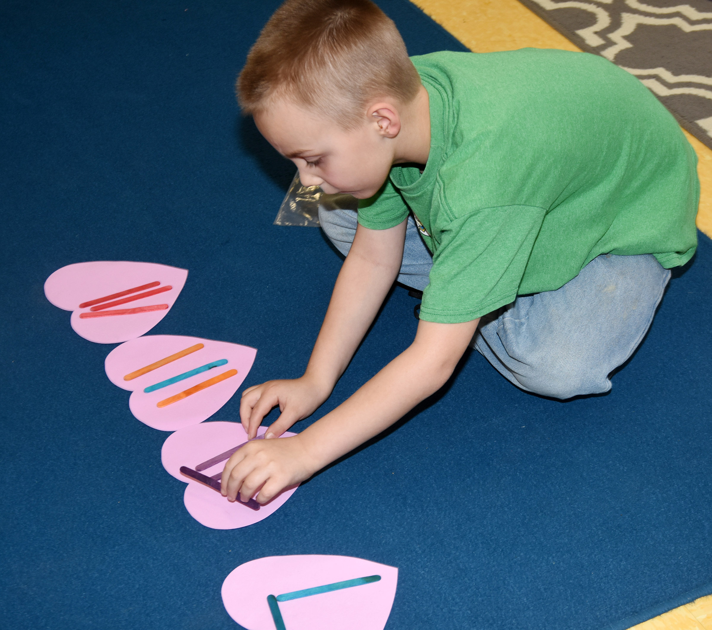 CES second-grader Hunter Bates writes a rhythm.