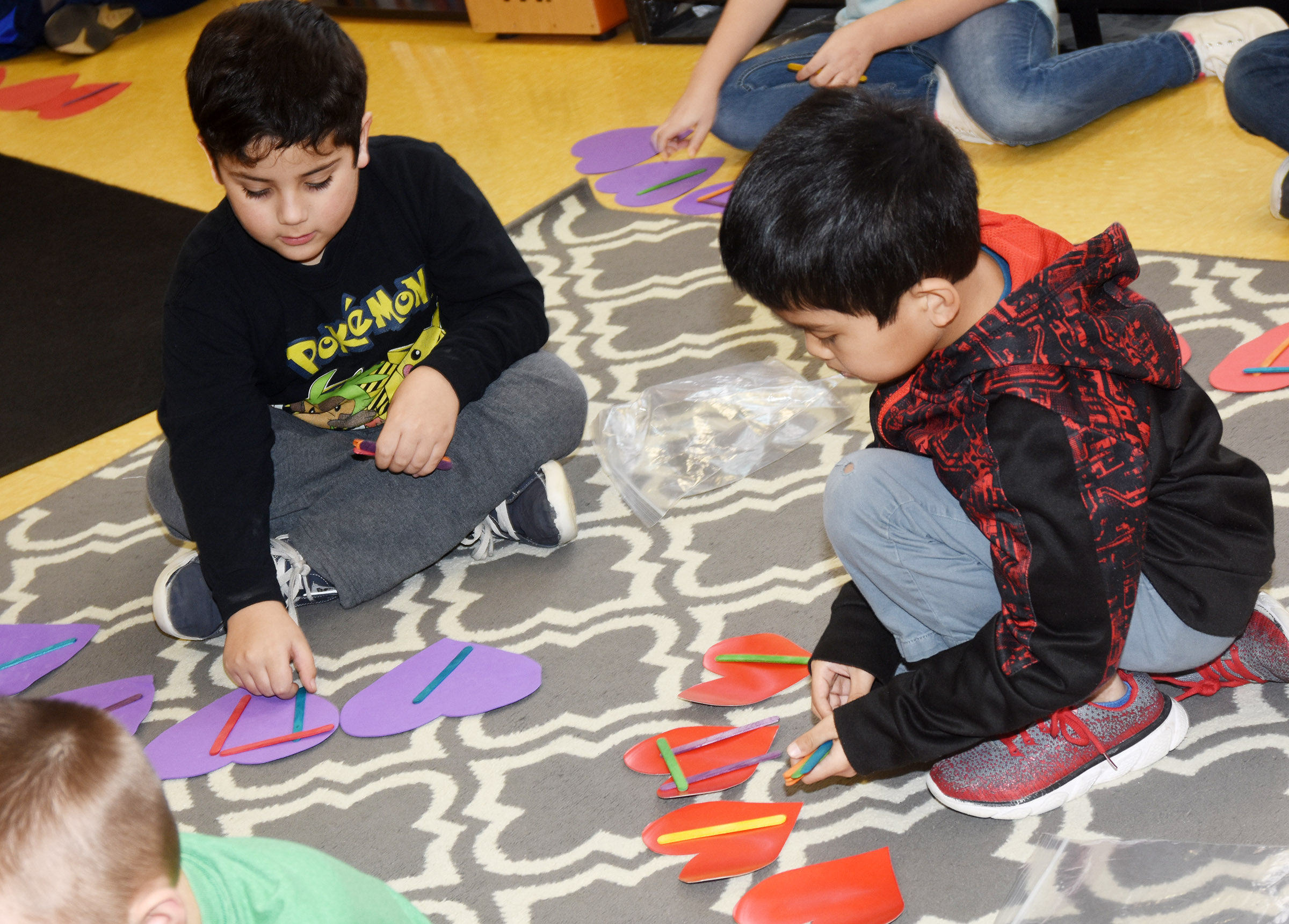 CES second-graders Nicholas Almeida, at left, and Zach Hak write rhythms.