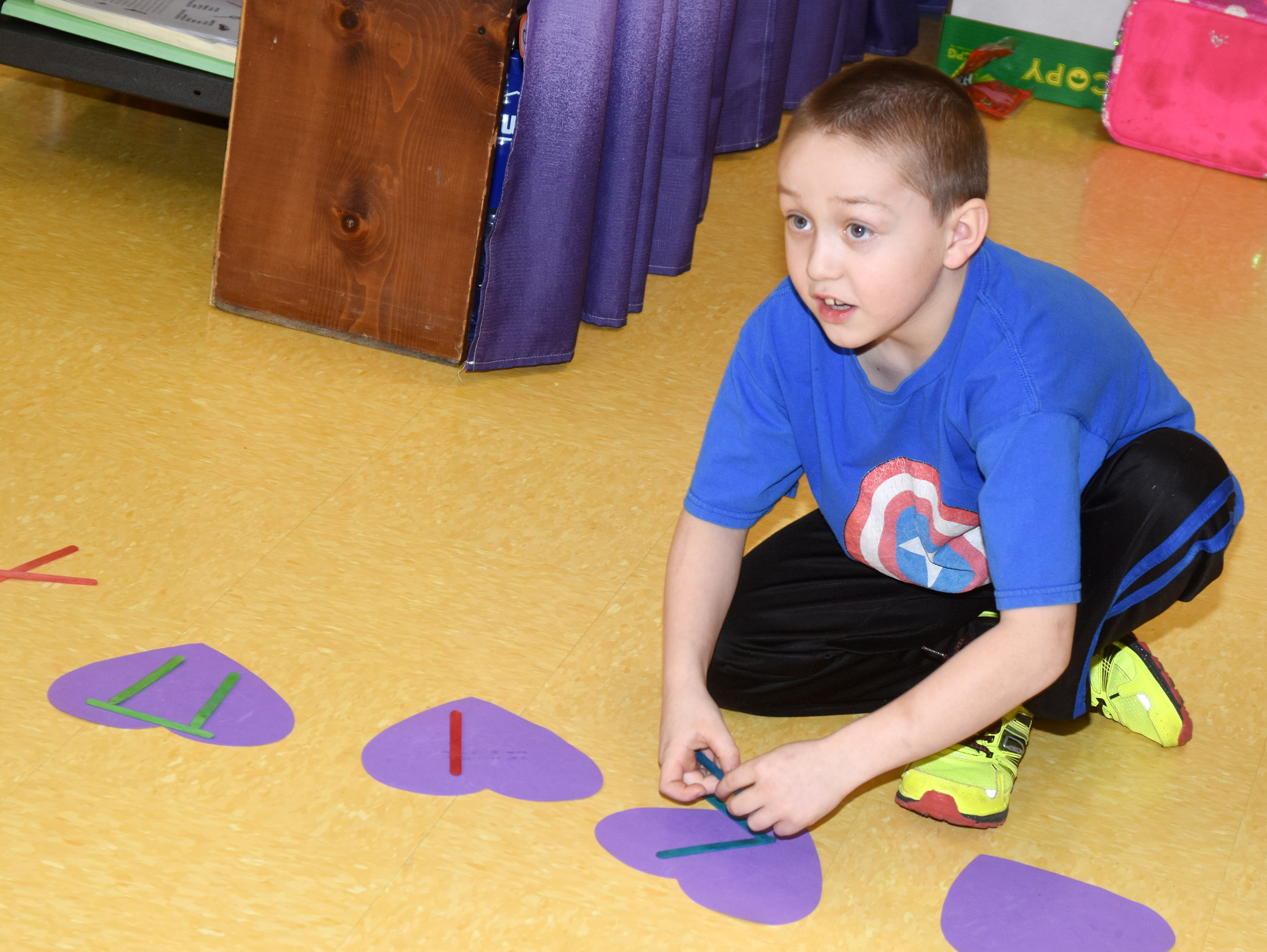 CES second-grader Jacob Golden writes a rhythm.