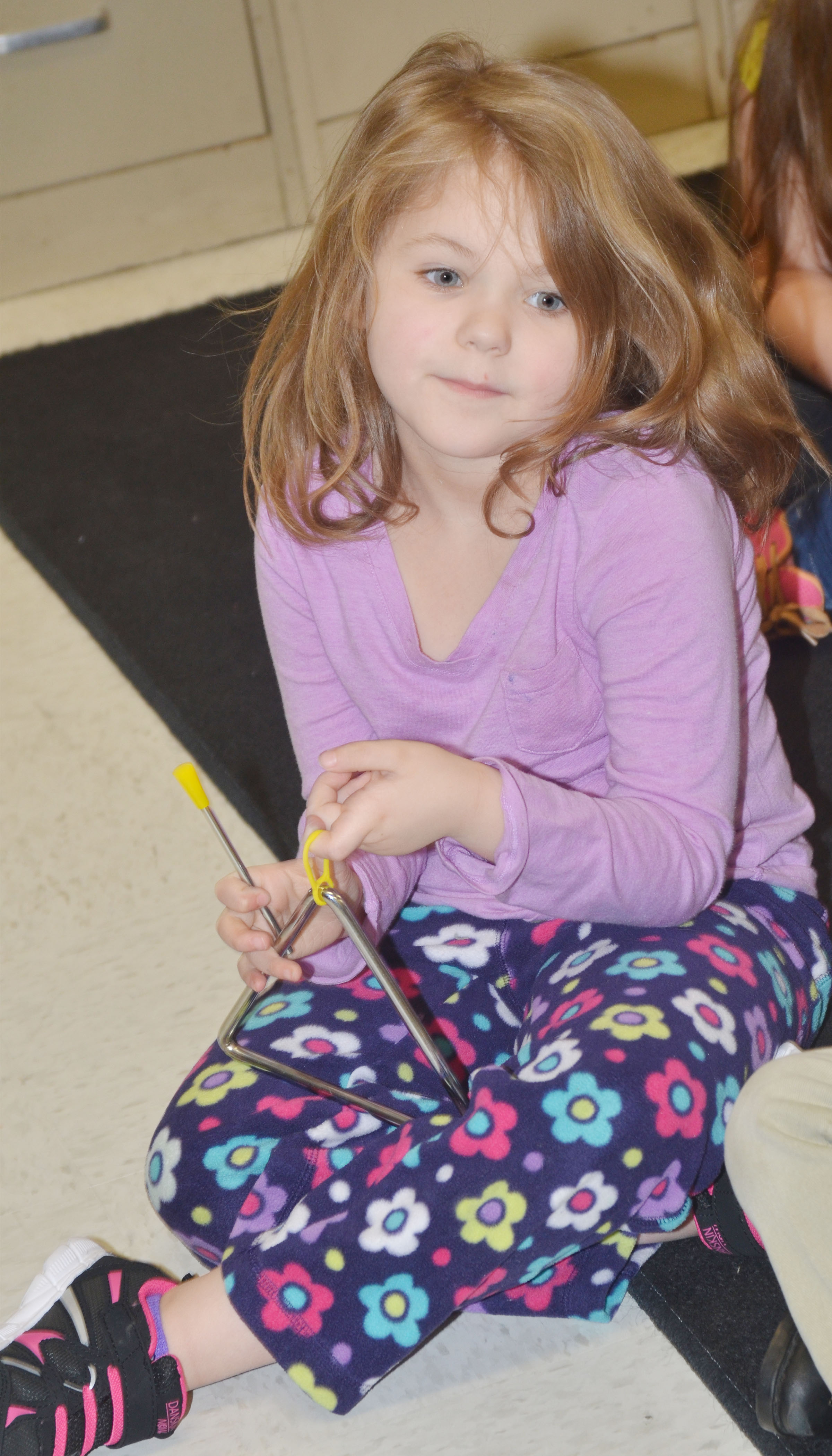 CES kindergartener Aubrey Wilson plays the triangle.