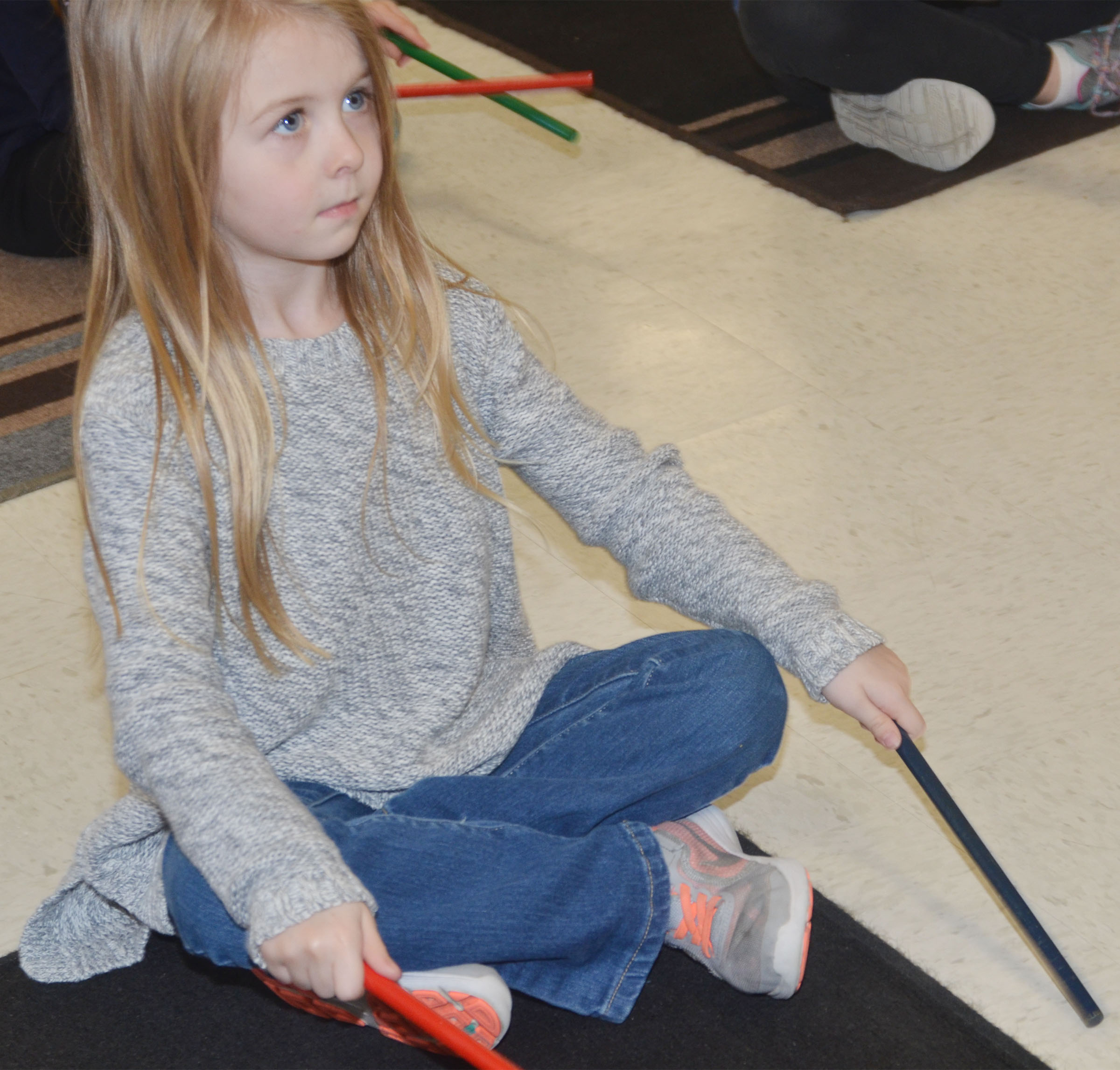 CES kindergartener Jewell Brewster plays the rhythm sticks.