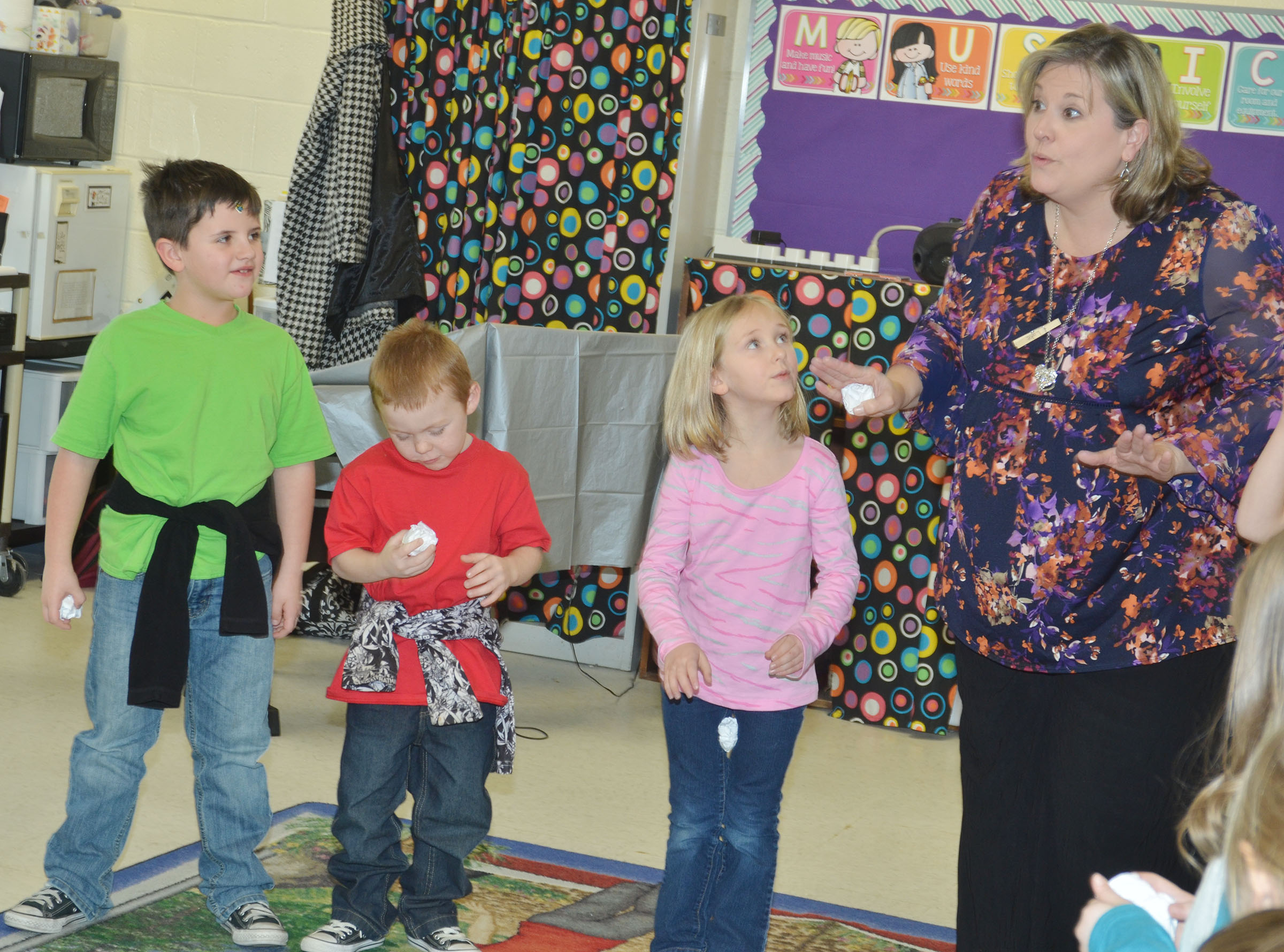 CES music teacher tells kindergarteners to sing their song about snow softly at first, and then very loud. From left are Casen Meredith, Daven Davis and LeeAnna Garvin.
