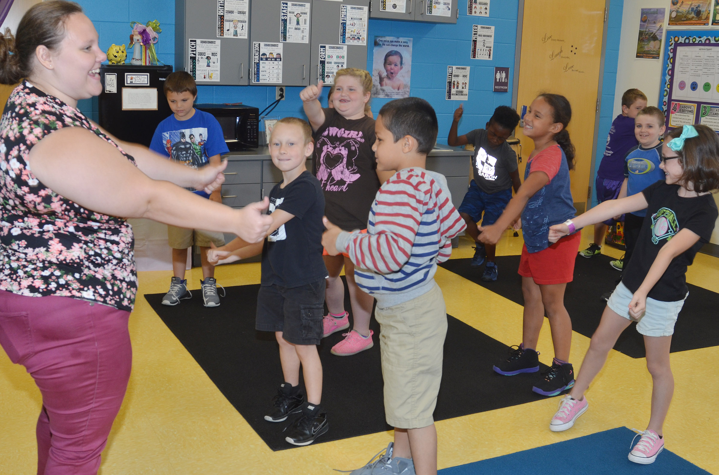 "Campbellsville University student teacher Coreena King leads CES second-graders in singing ""A Tooty Tay."""