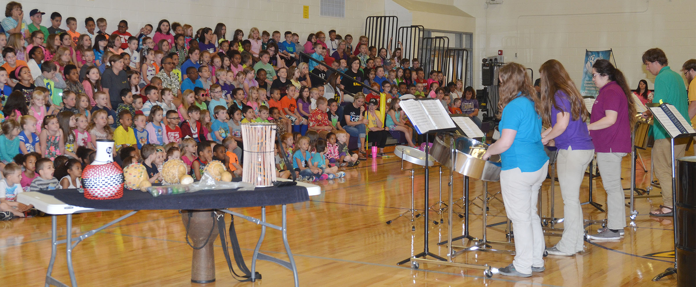 CU Steel Band members perform for CES students.