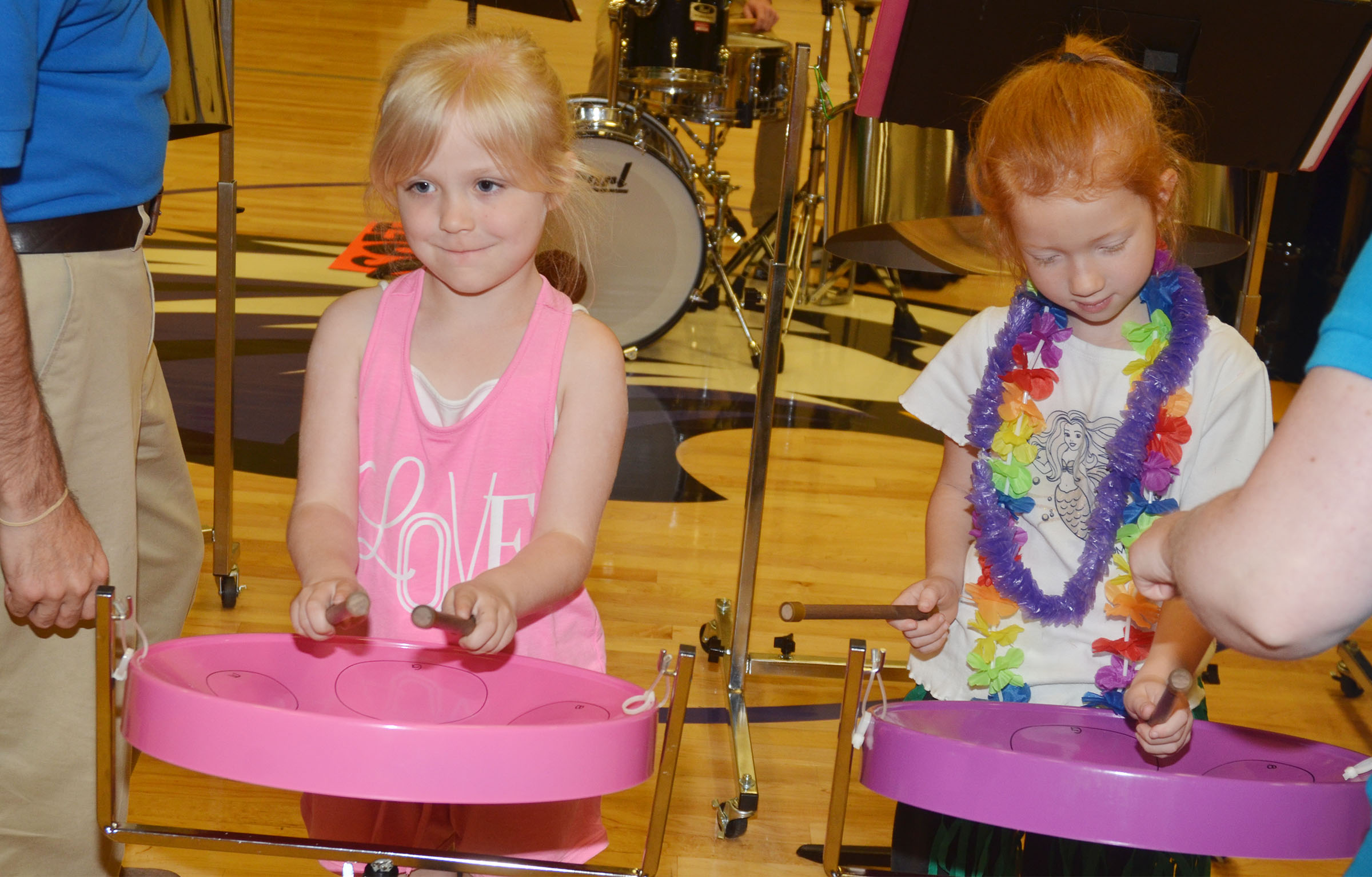 CES kindergarteners Ava Bennett-Marr, at left, and Isabella Stout play the steel drums.