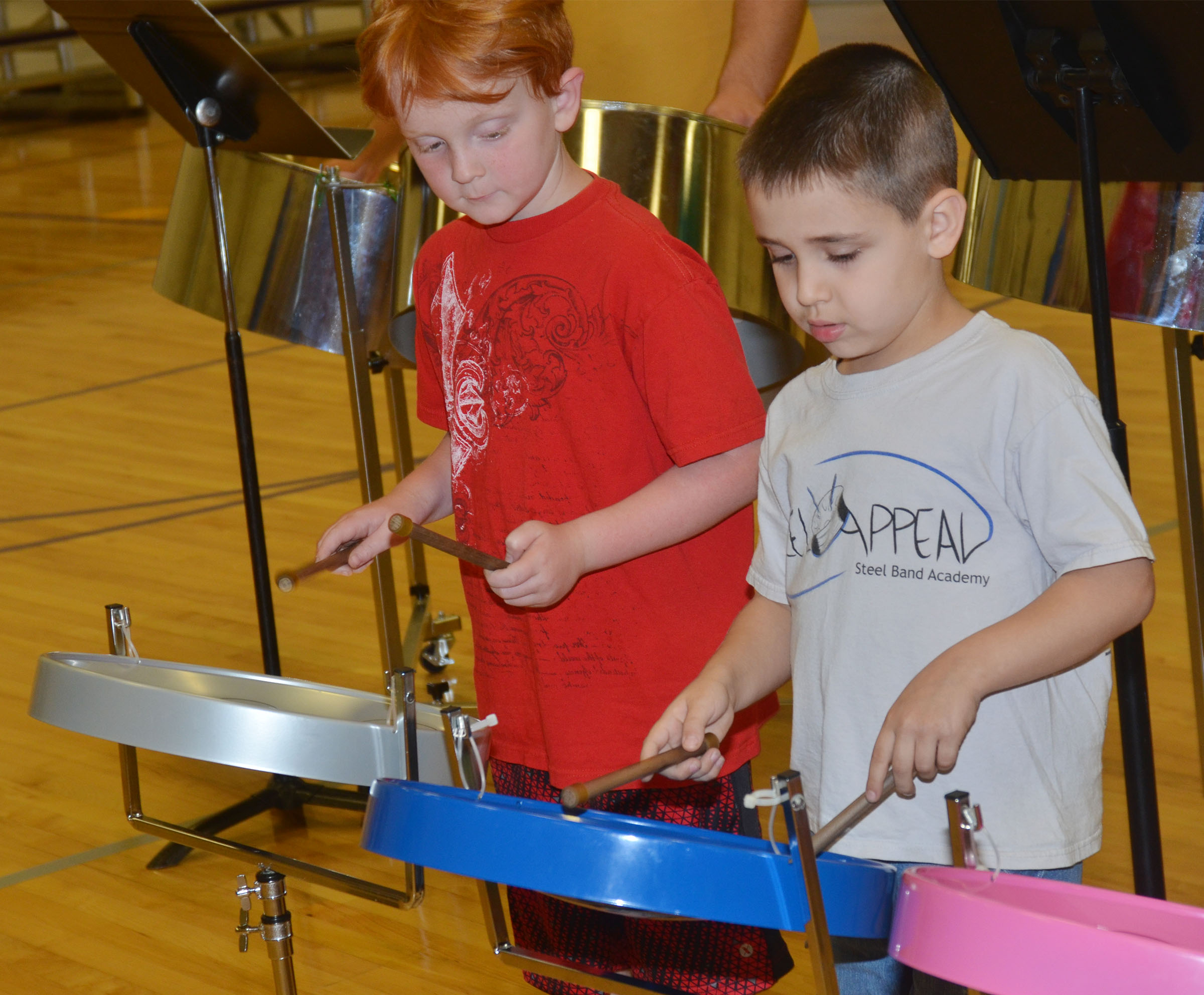 CES second-grader Gavin Martin, at left, and first-grader Aaron Floyd play the steel drums.