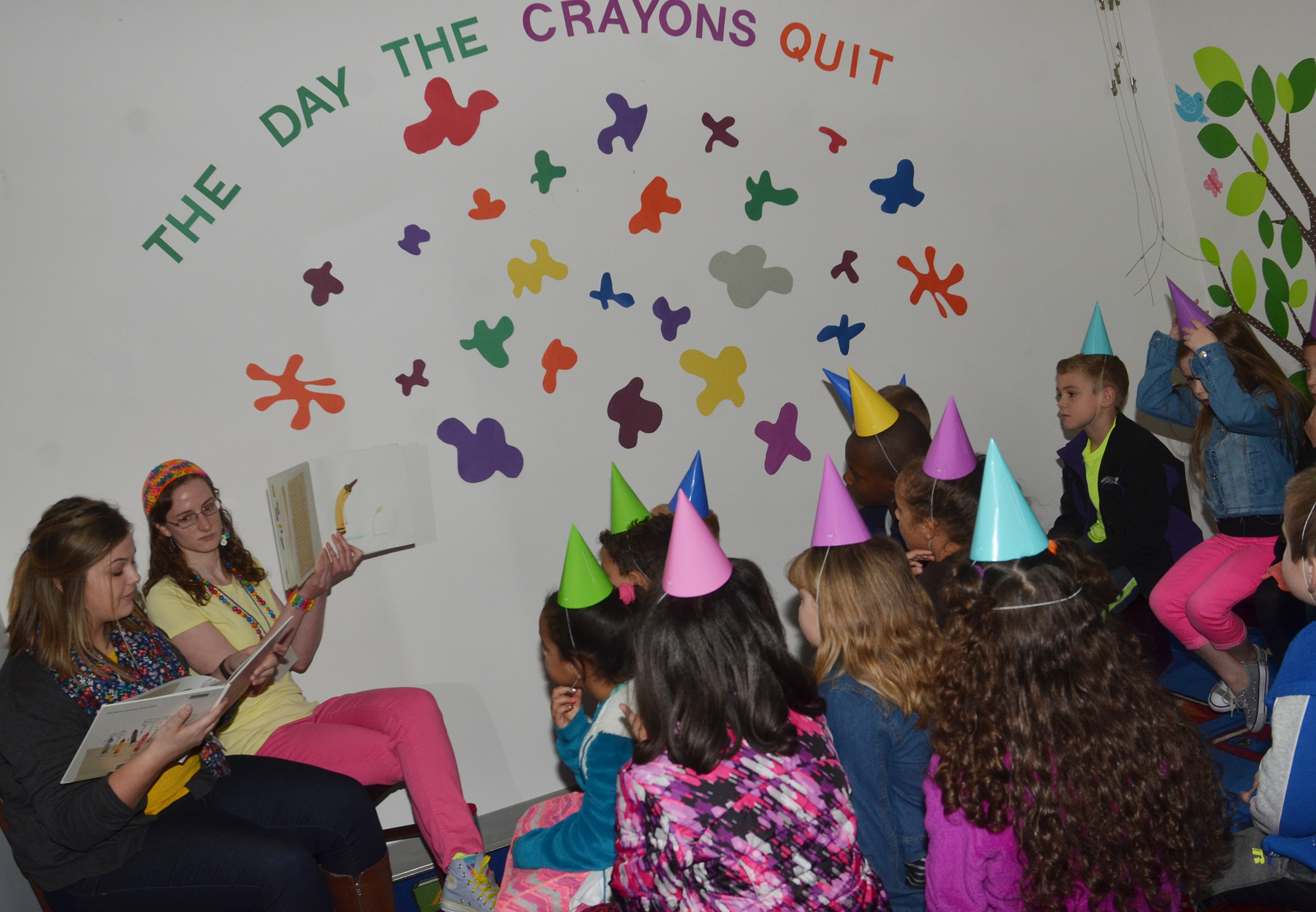 "CES first-grade students listen to ""The Day the Crayons Quit"" by Drew Daywalt."