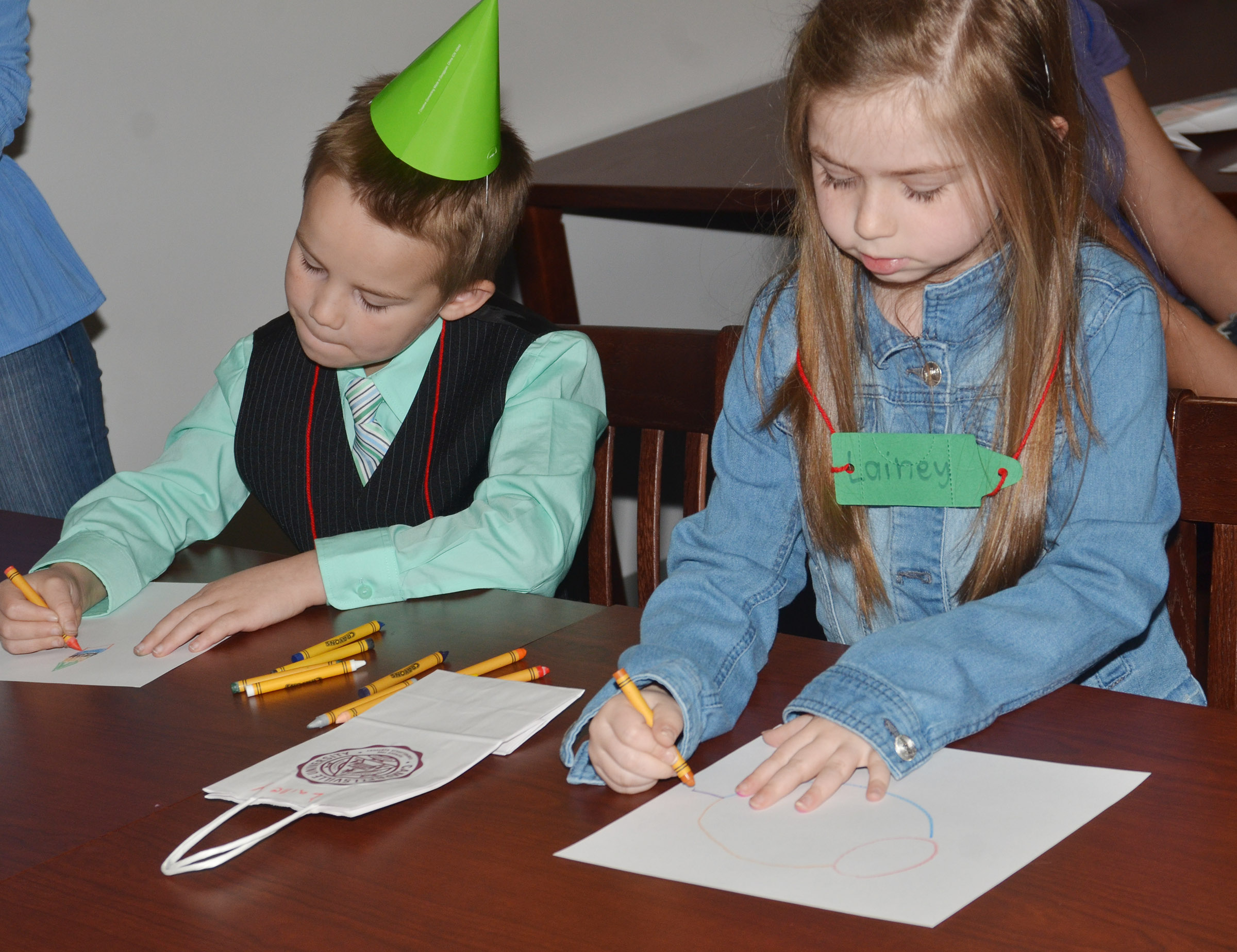 CES first-graders Jackson Bates, at left, and Lainey Price color together.