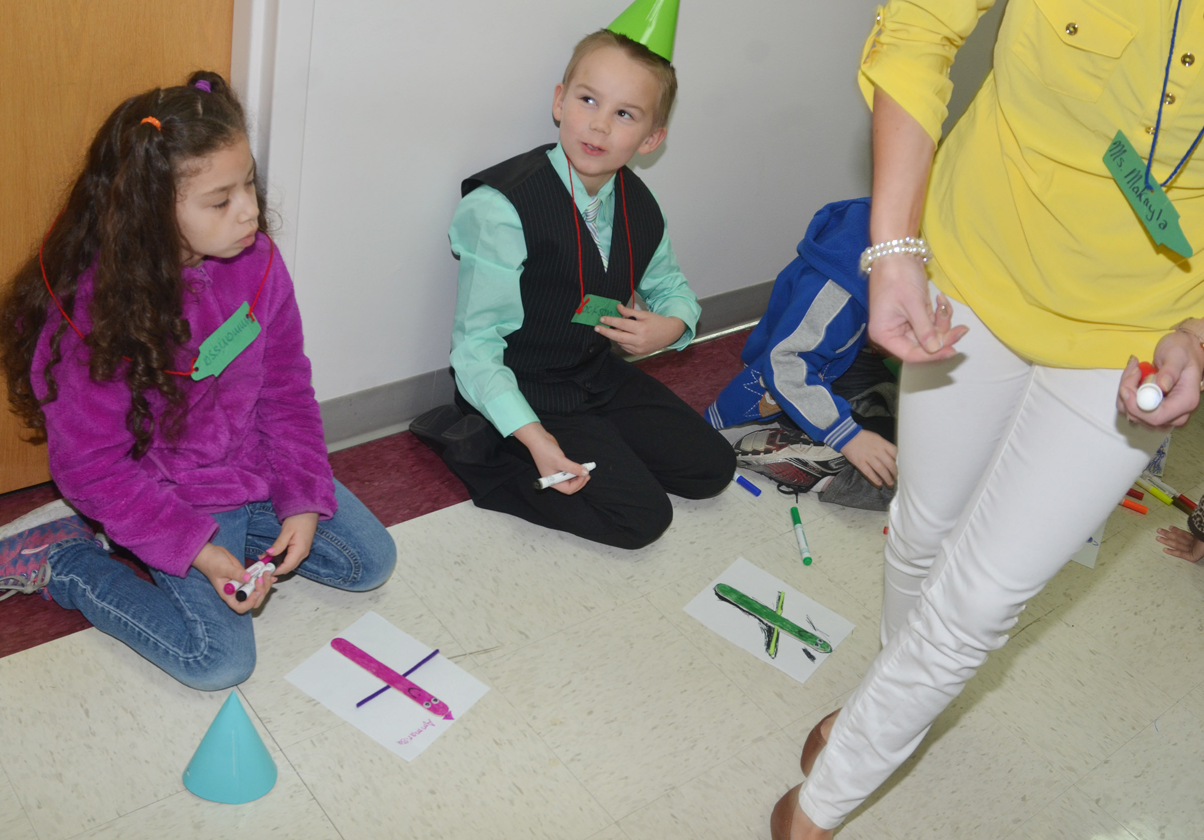 CES first-graders Ammarissa Nunez, at left, and Jackson Bates make their own crayon people.