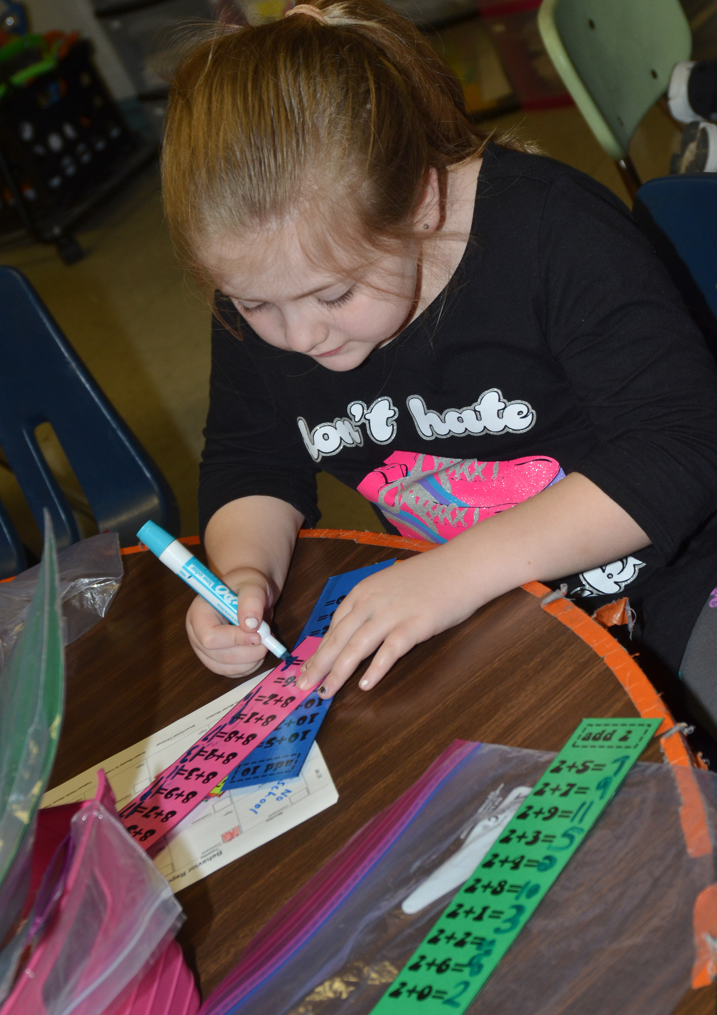 CES first-grader London Whitlow writes her multiplication tables.