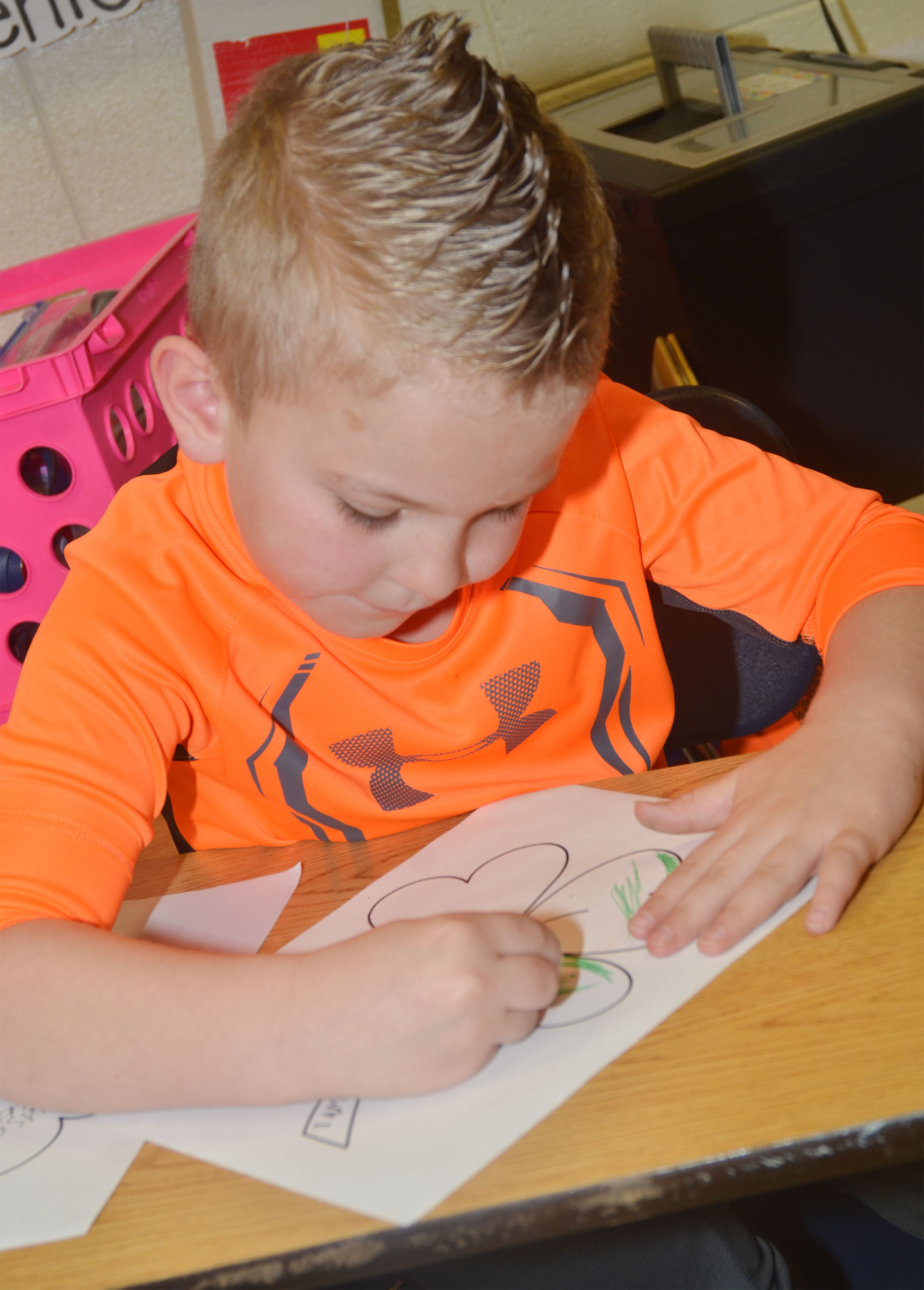 CES first-grader Ethan Bailey colors his shamrock.