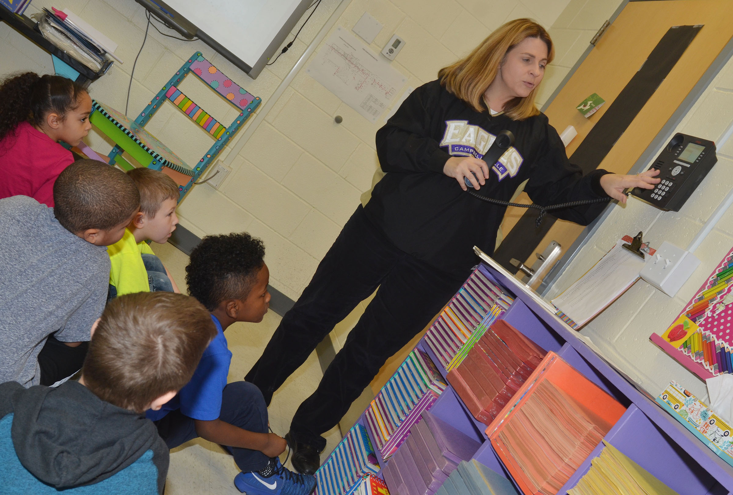 CES Guidance Counselor Sonya Orberson shows students how to call 911 in case of an emergency.