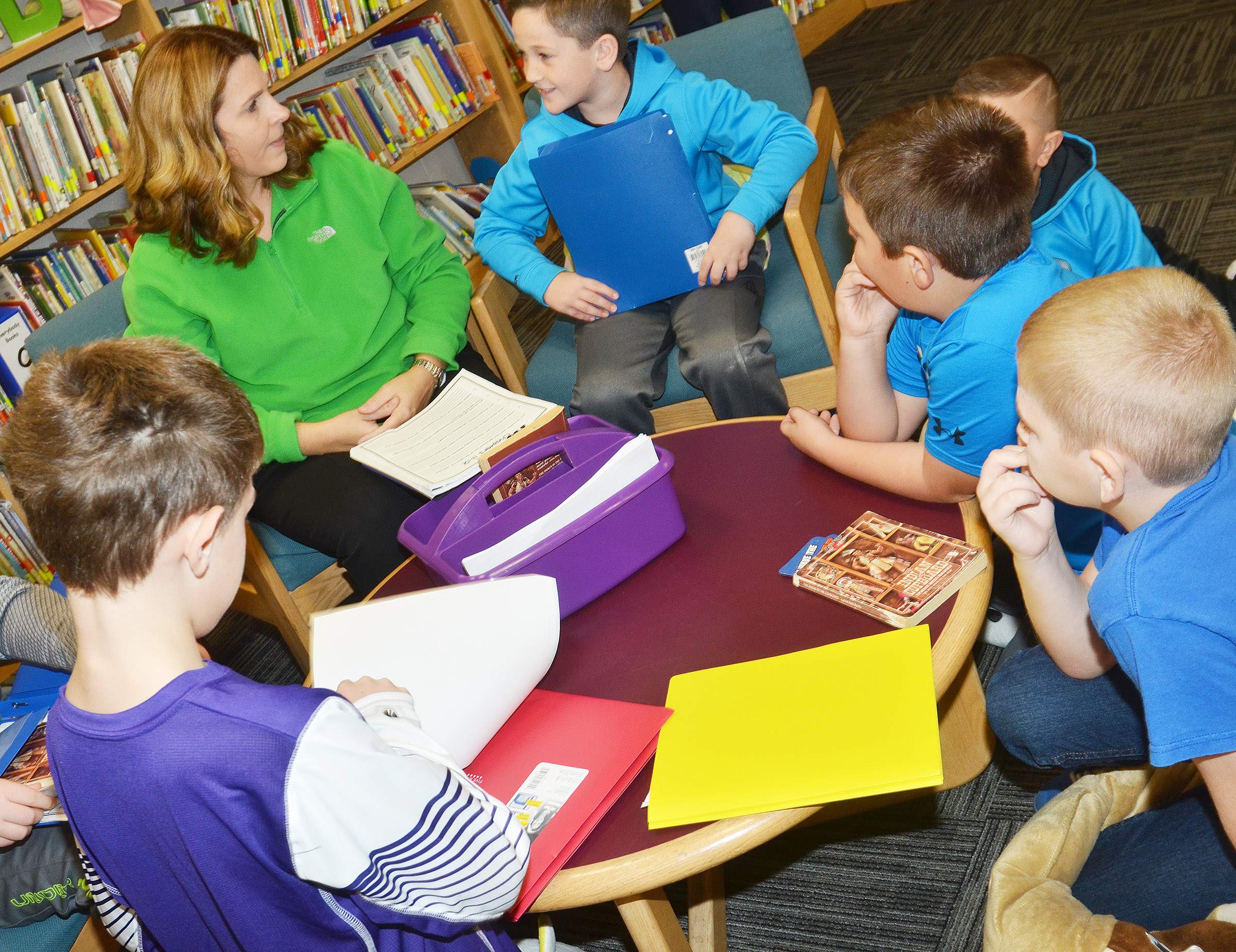 "CES Guidance Counselor Sonya Orberson discusses ""The Indian in the Cupboard"" with, clockwise from left, third-graders Aidan Wilson, Luke Adkins, Cayton Lawhorn, Hayden Maupin and Joseph Greer."
