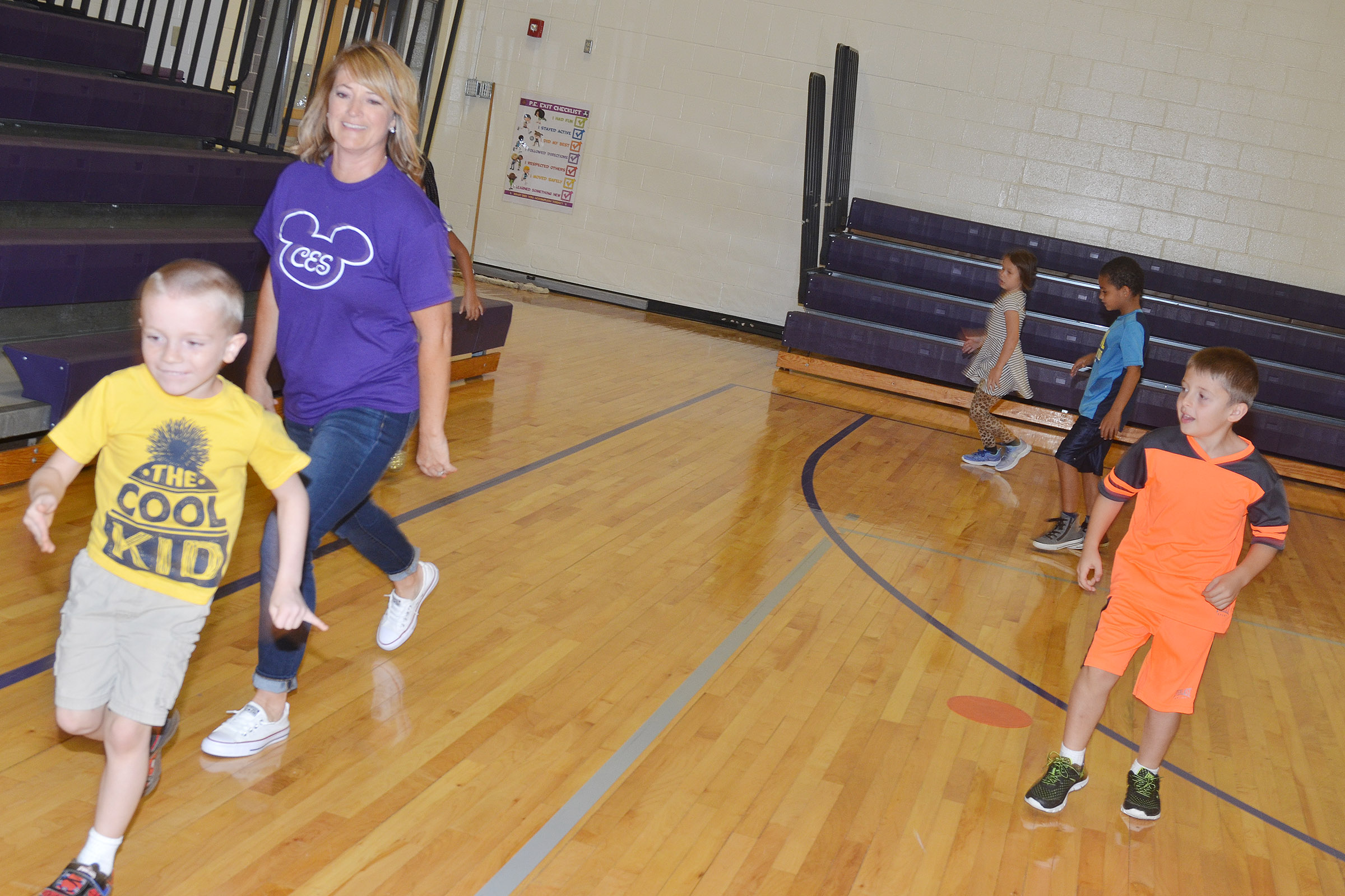 CES teacher Vanessa Adkins skips with first-grader Jason Eggers.
