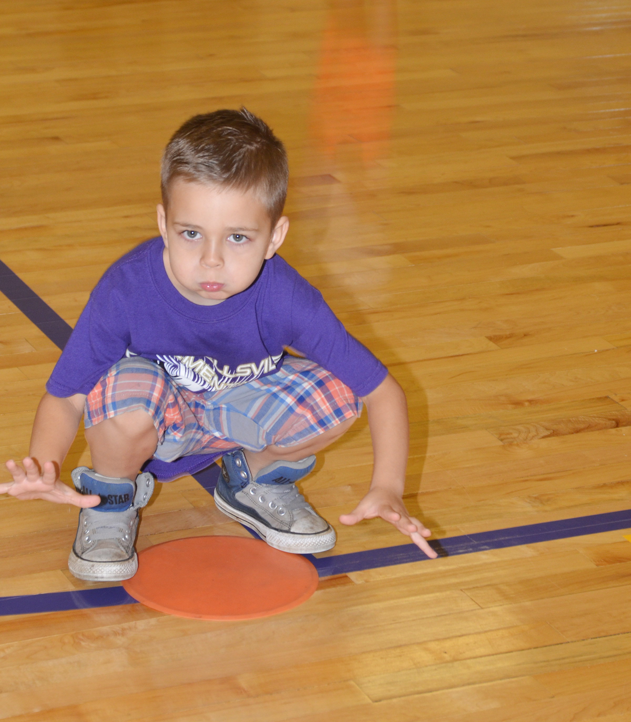 CES first-grader Michael Terry lunges.