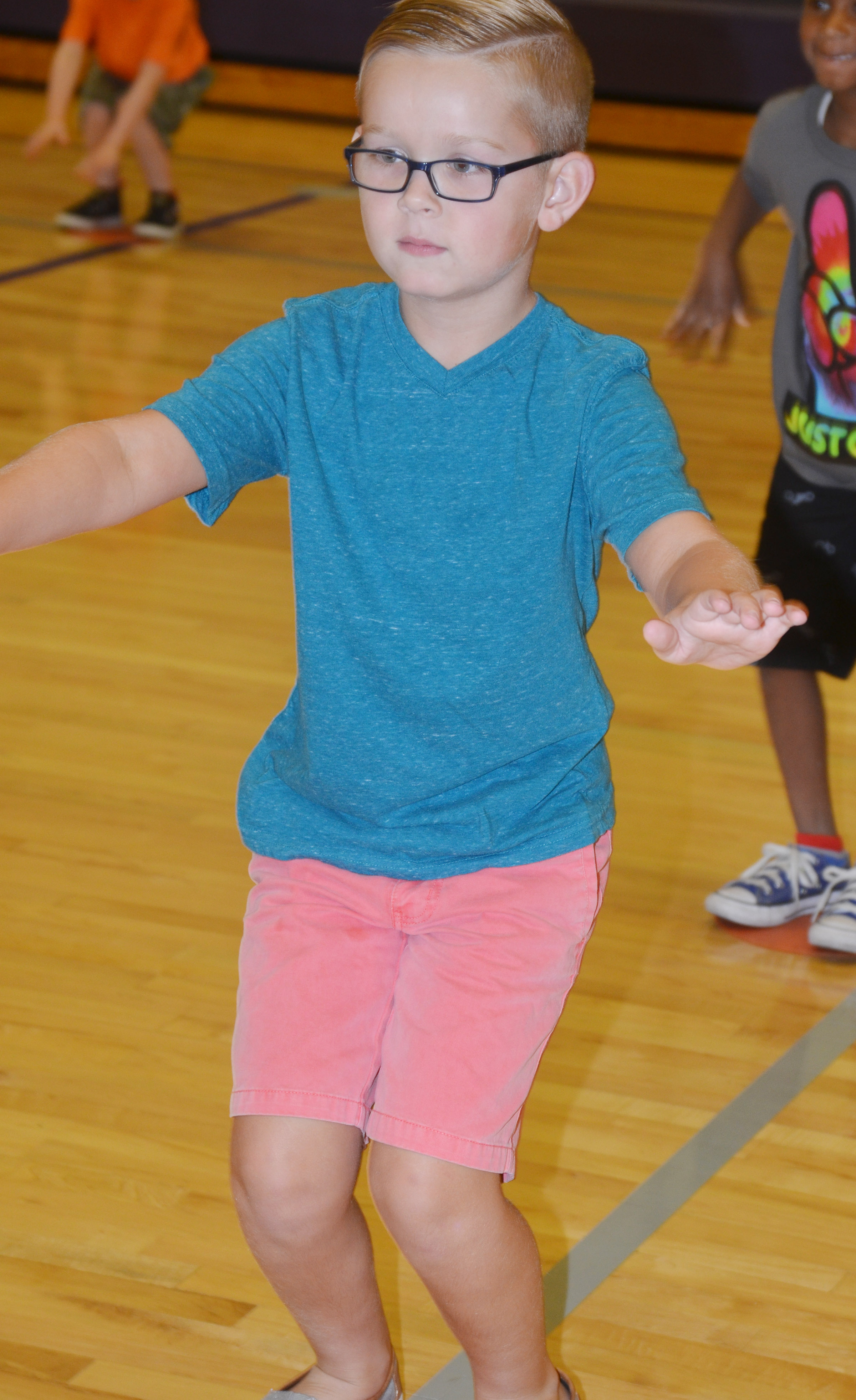 CES first-grader John Hagan Newton exercises.