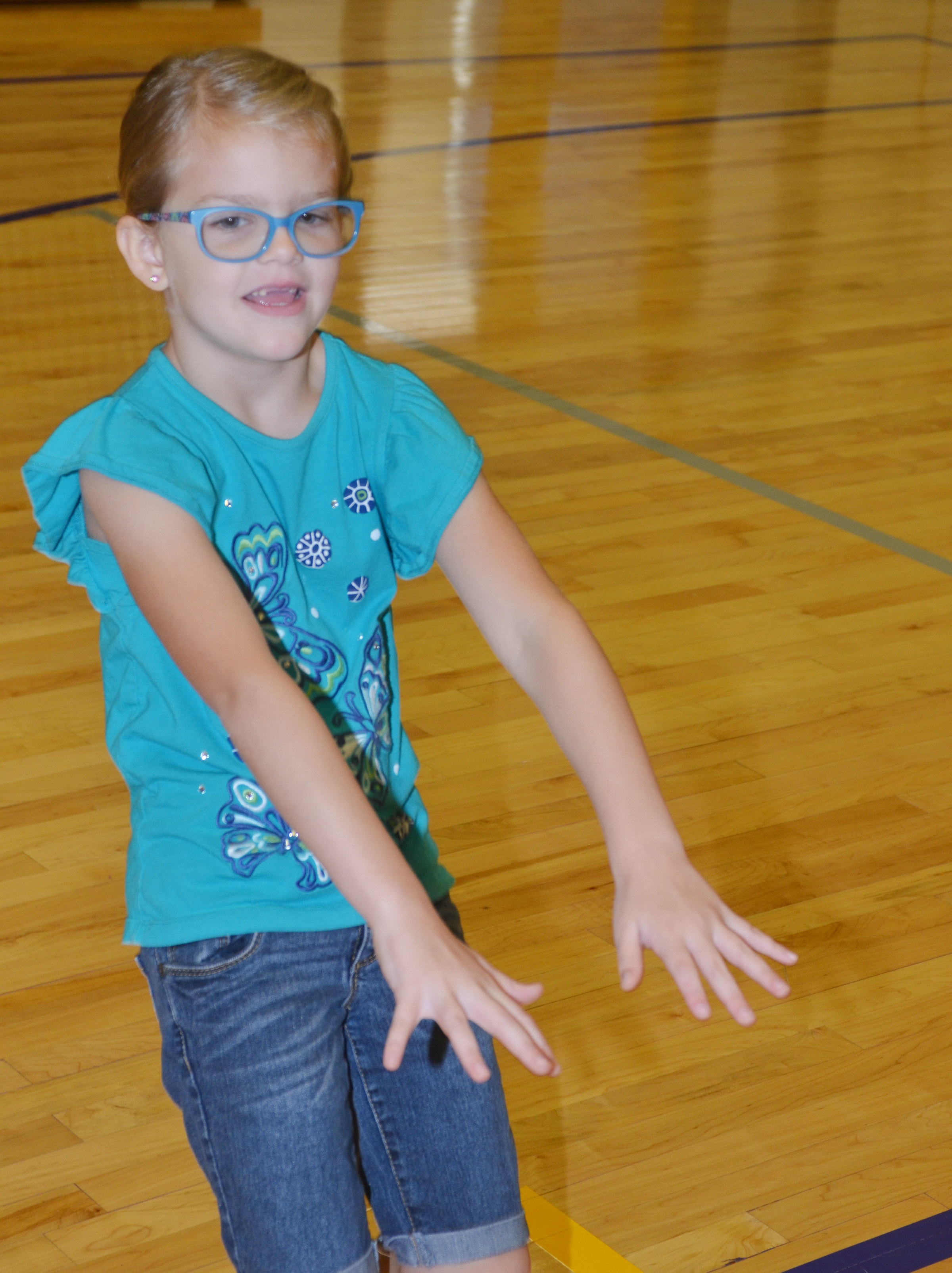 CES first-grader Zoe Weddle exercises.