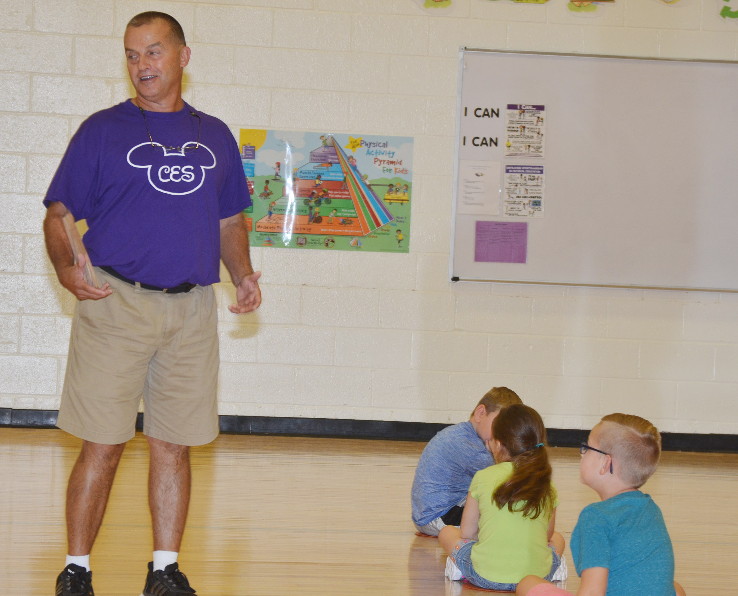 CES physical education teacher Lynn Kearney talks to his students.