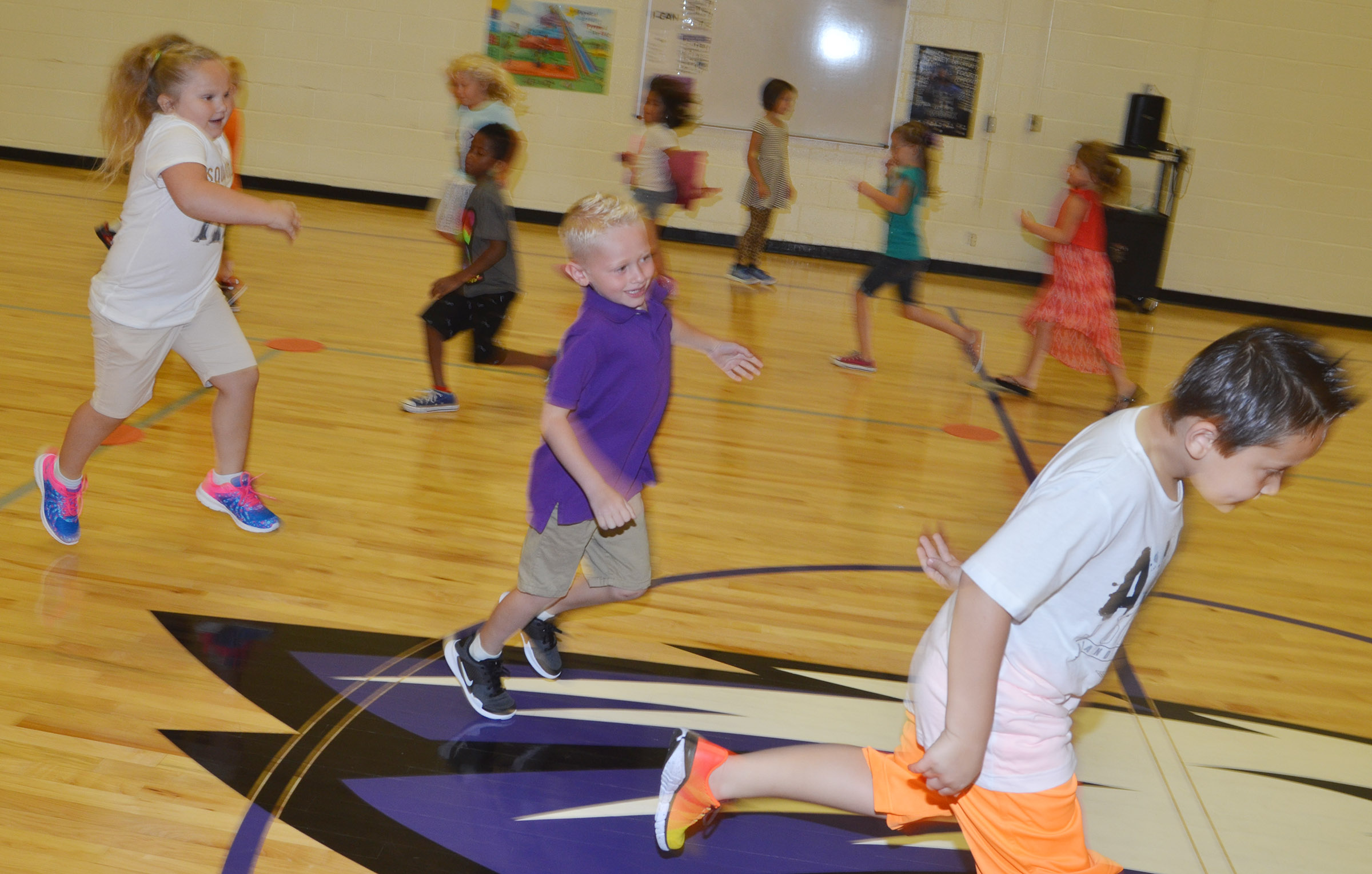 CES first-graders run in the gym.