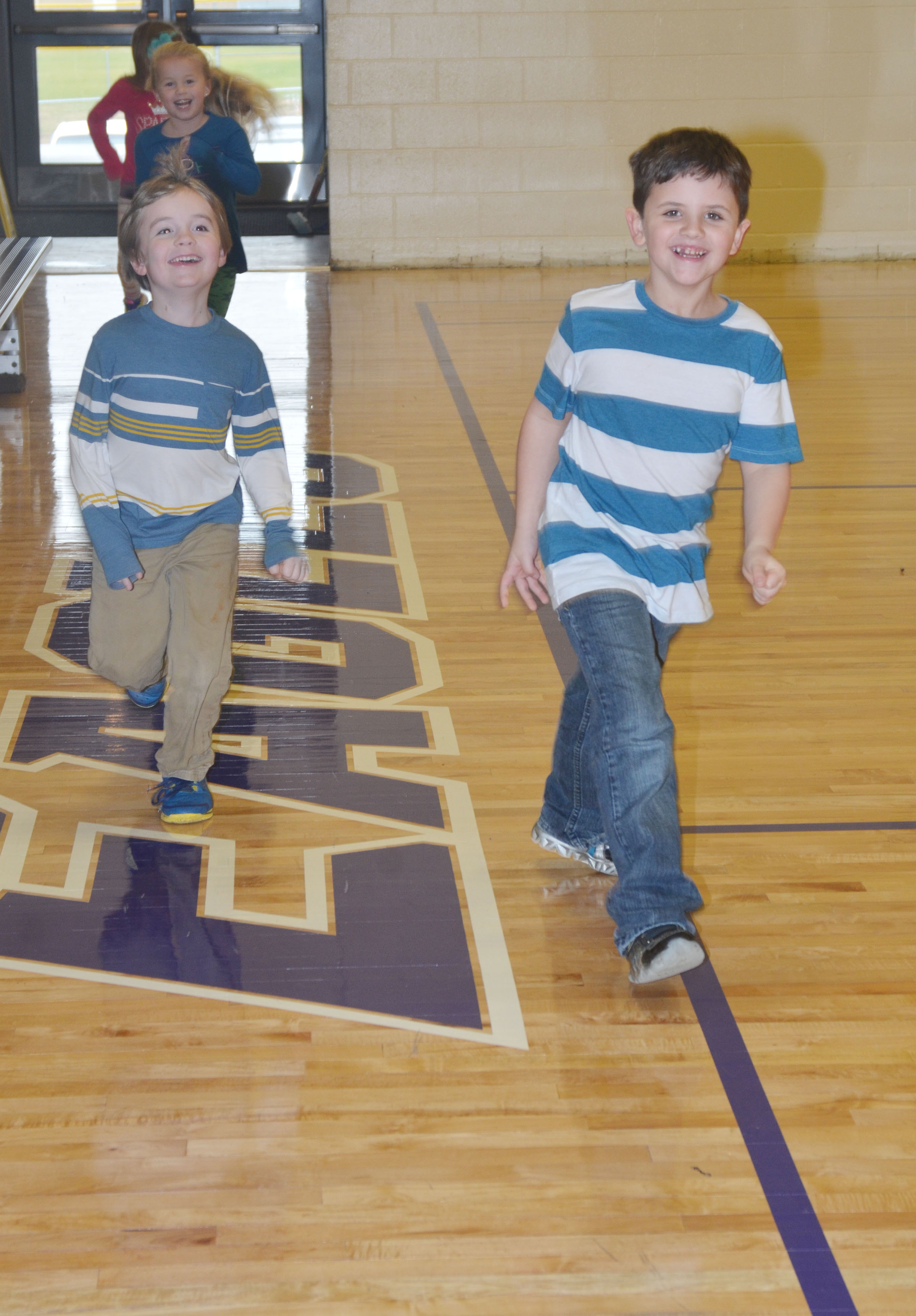 CES kindergarteners Gavin Williams, at left, and Casen Meredith walk around the new gymnasium.