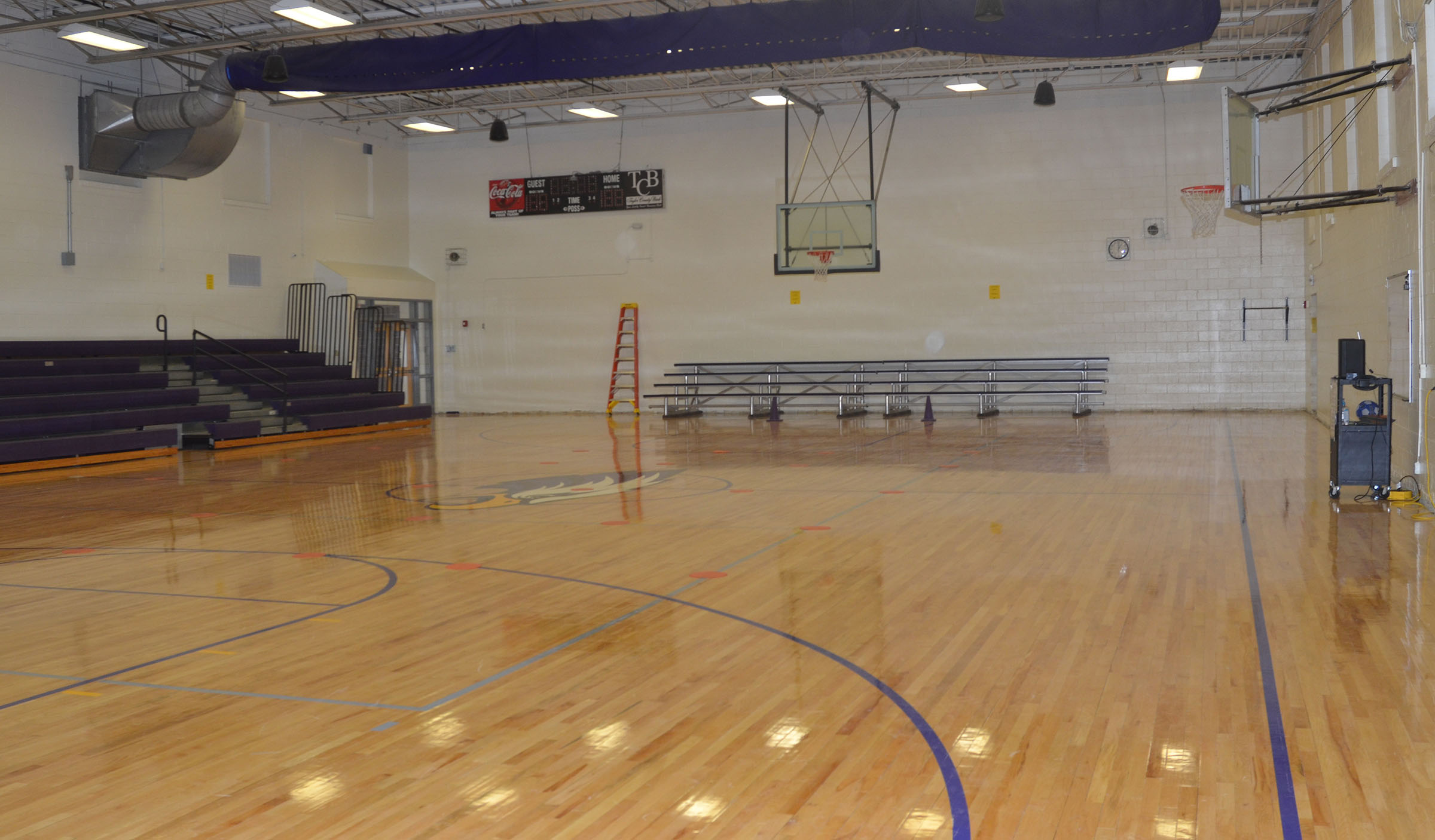 The CES gymnasium was recently renovated. The floor was refinished with a new design, the walls were painted and new bleachers were installed.