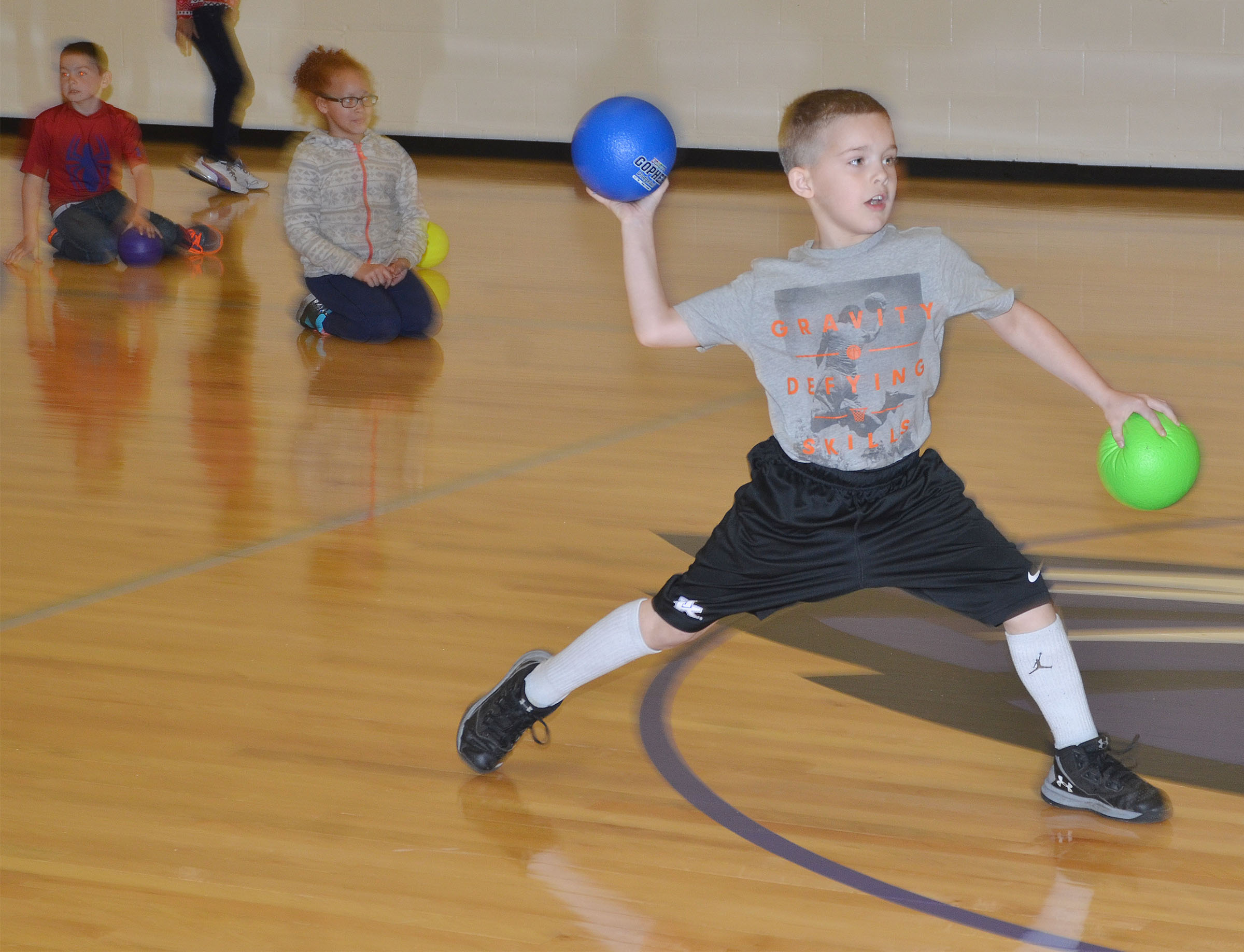 CES second-grader Kadin Coppage throws a dodgeball.
