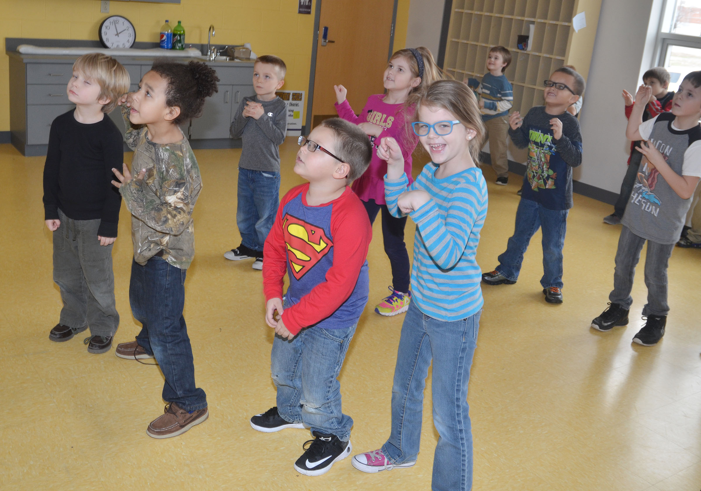 CES kindergartener Zoe Weddle smiles as she dances with her classmates.