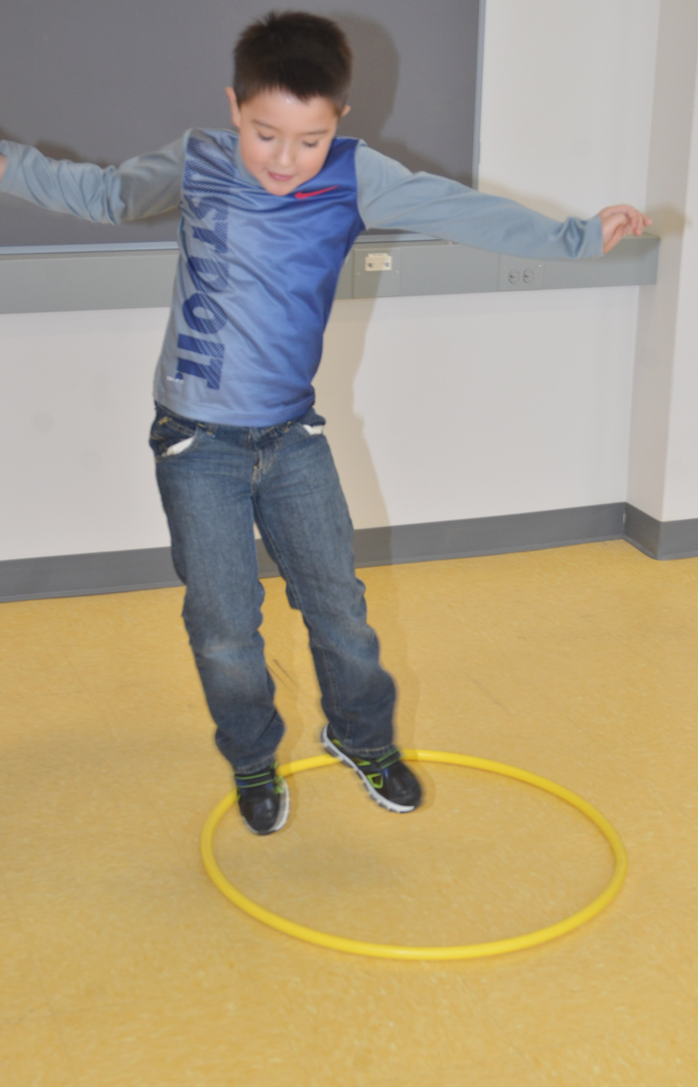 CES first-grader Braxton Giles-Osinger jumps in his hula hoop.