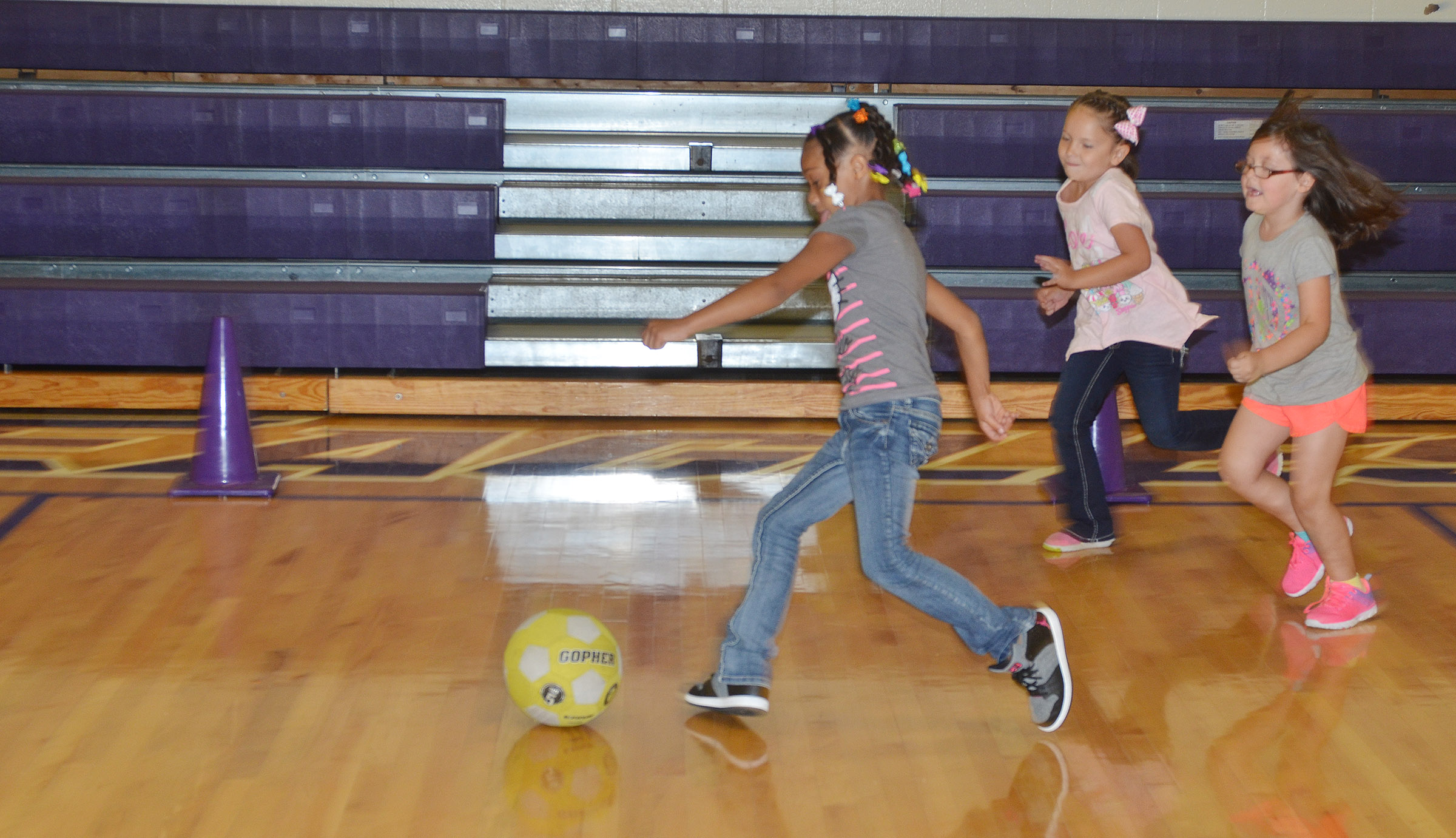 CES first-grader Jyra Welch kicks the soccer ball.
