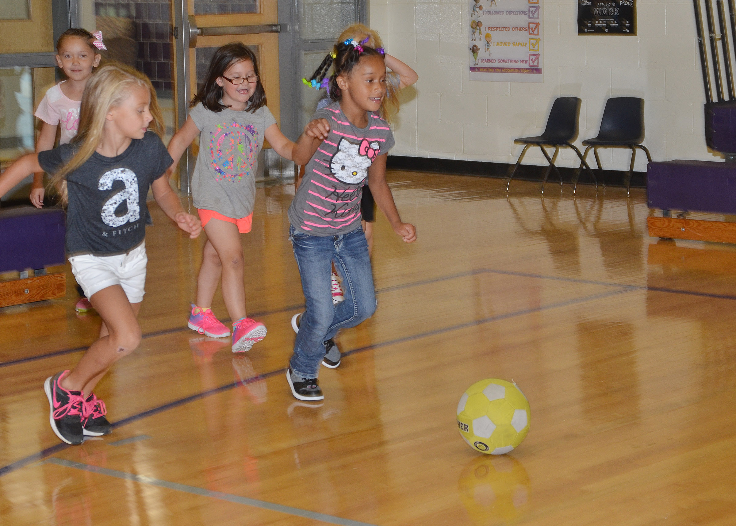 CES first-grader Jyra Welch kicks the soccer ball to the goal.