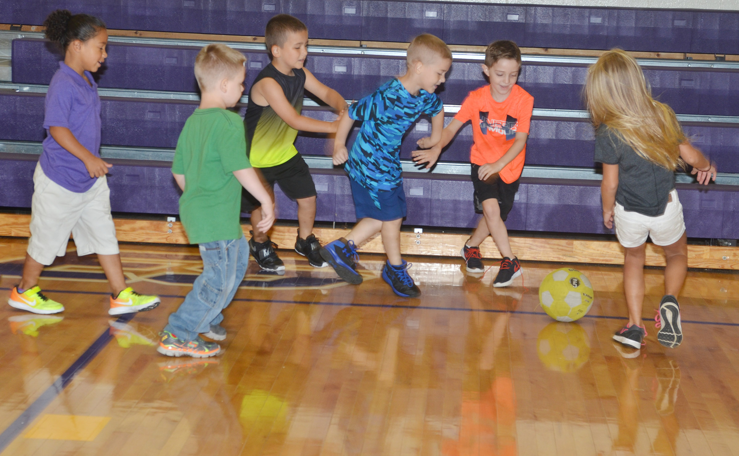 CES first-grader Caleb Goodson kicks the soccer ball.