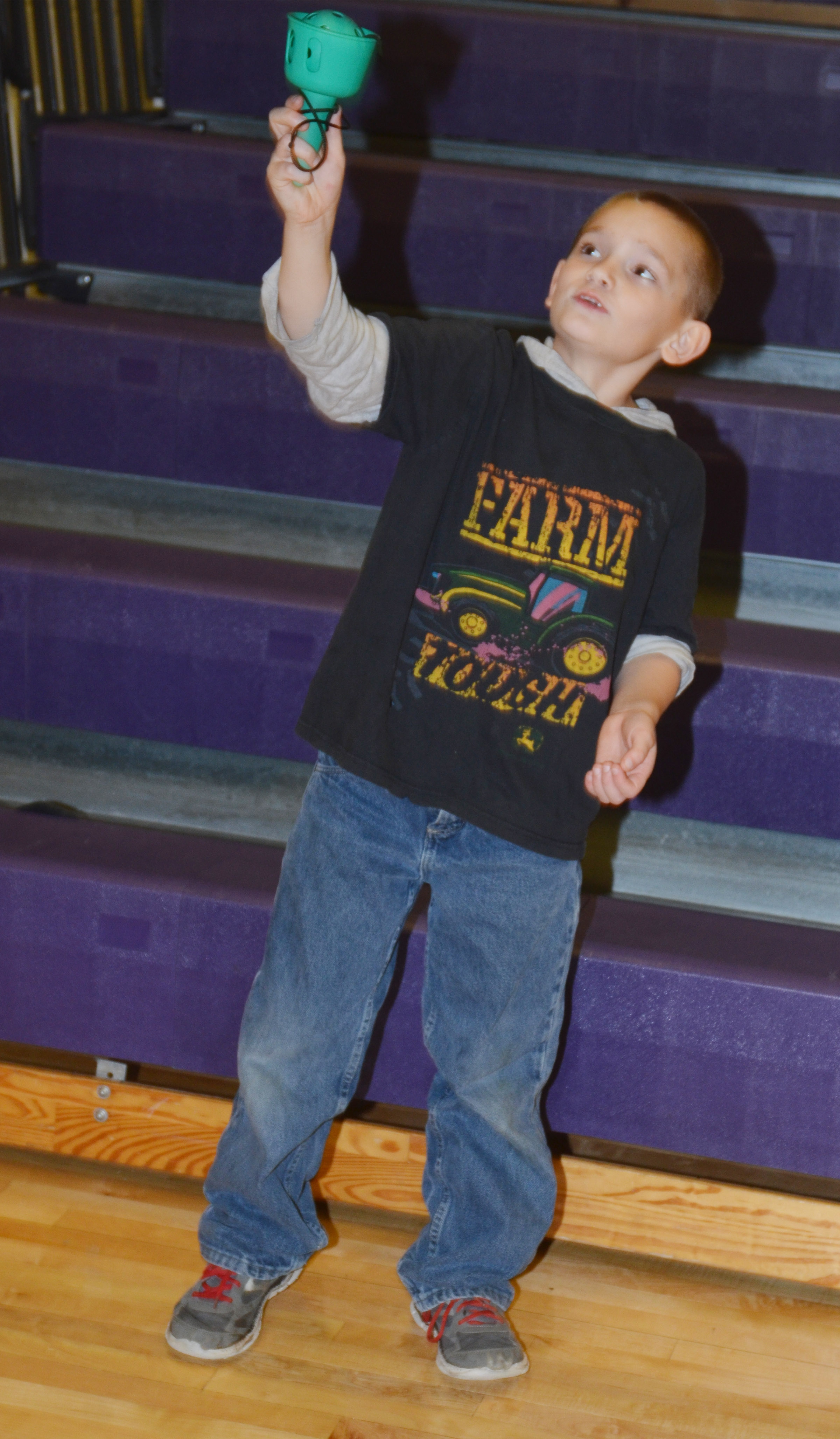 CES second-grader Sean Welch tries to catch a ball in a cup.