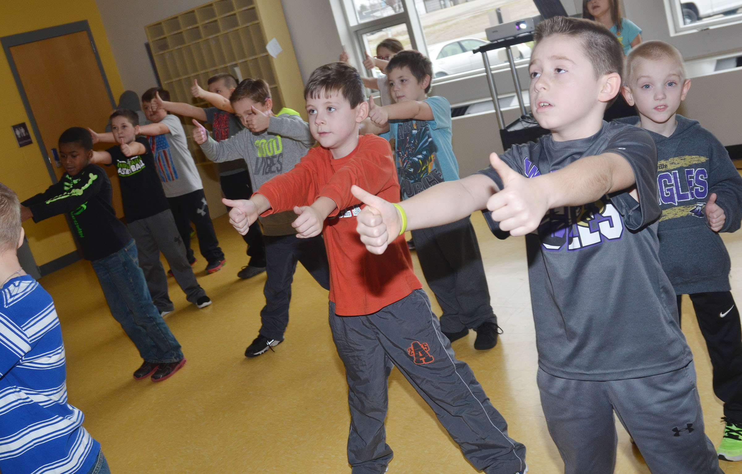 CES second-graders put their thumbs up as they work out. In front are Ryan Tungate, at left, and Lanigan Price.