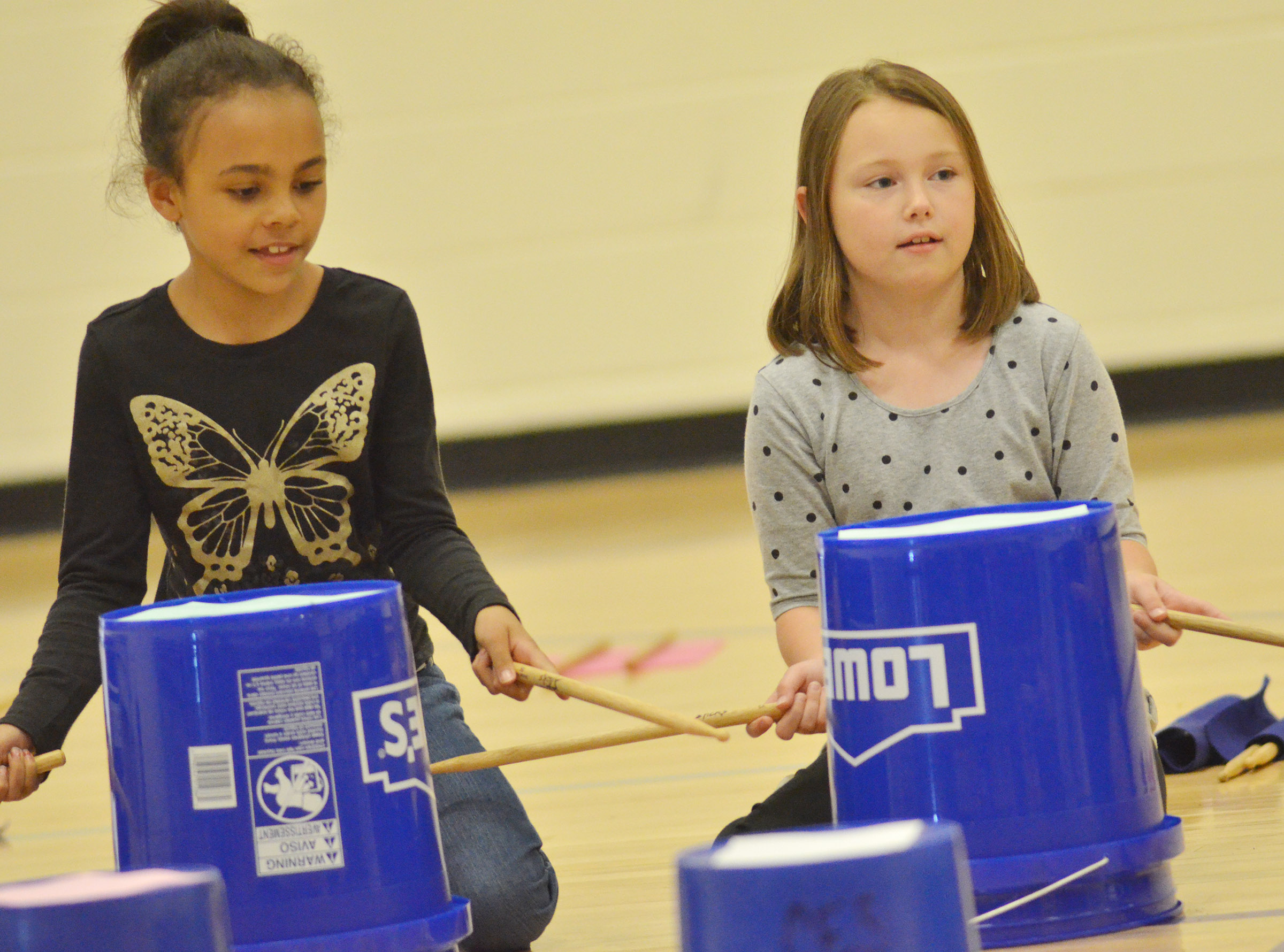 CES second-graders Braelyn Taylor, at left, and River McFarland drum.